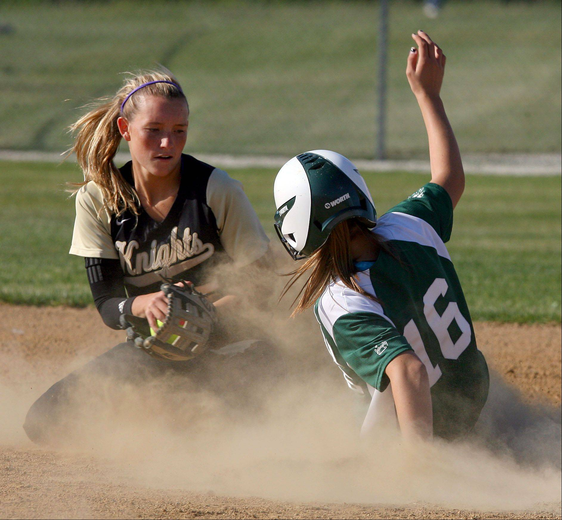 Grayslake North�s Jordyn Bowen, left, tries to tag Grayslake Central�s Caitlin Flary during Class 3A regional semifinal play last spring at Antioch.