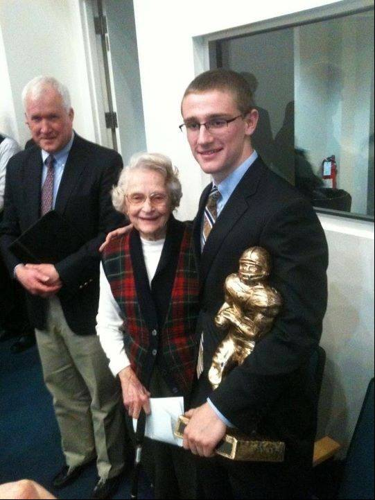 St. Edward graduate Luke Duffy, right, receives a scholarship award from Bears owner Virginia McCaskey on behalf of the National Football Foundation. Duffy, now a freshman at Washington University in St. Louis, has been nominated for a national award from the NFF.