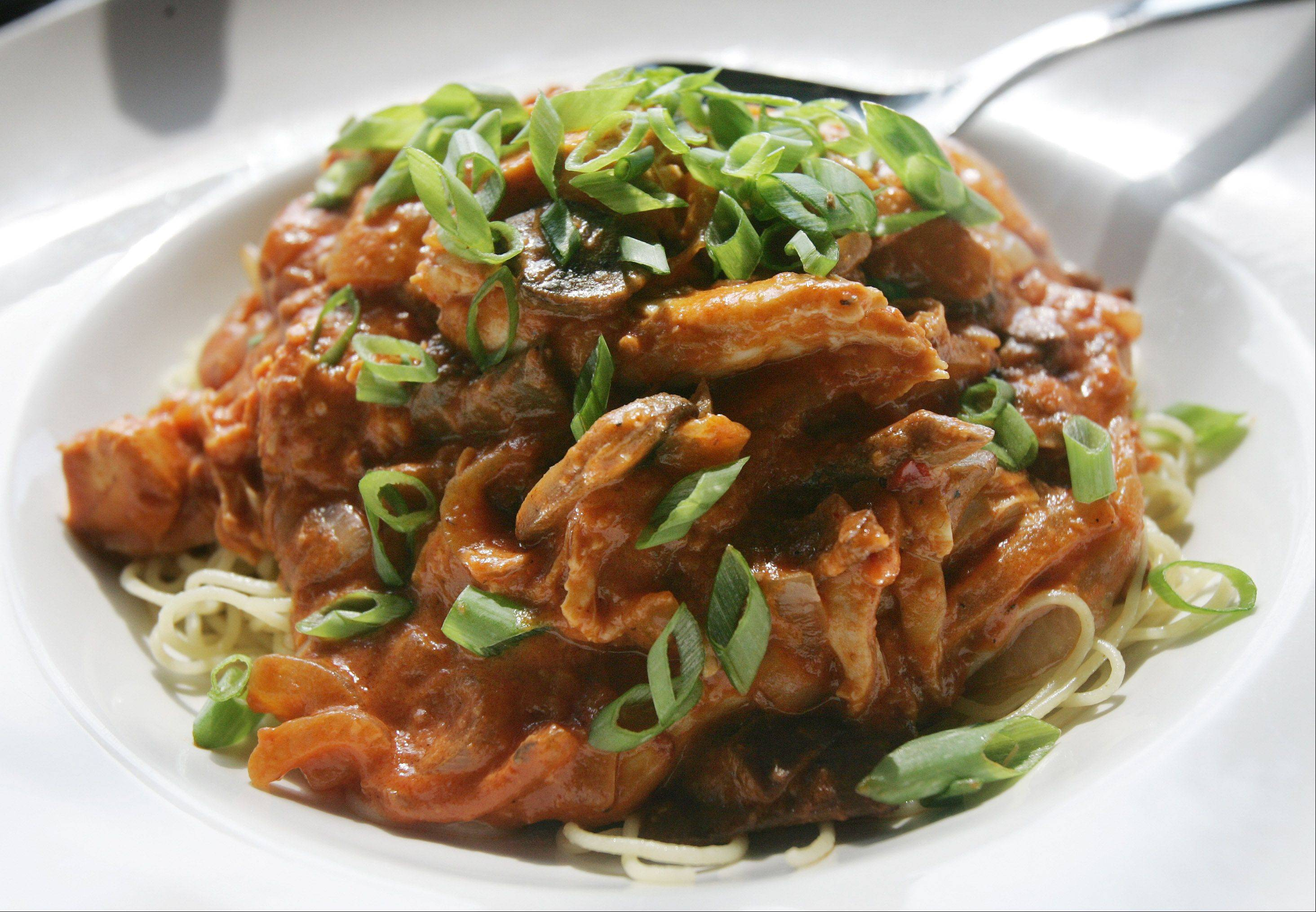 "A bowl of African chicken chili can be customized with a pasta or potato ""foundation"" and a variety of toppings."