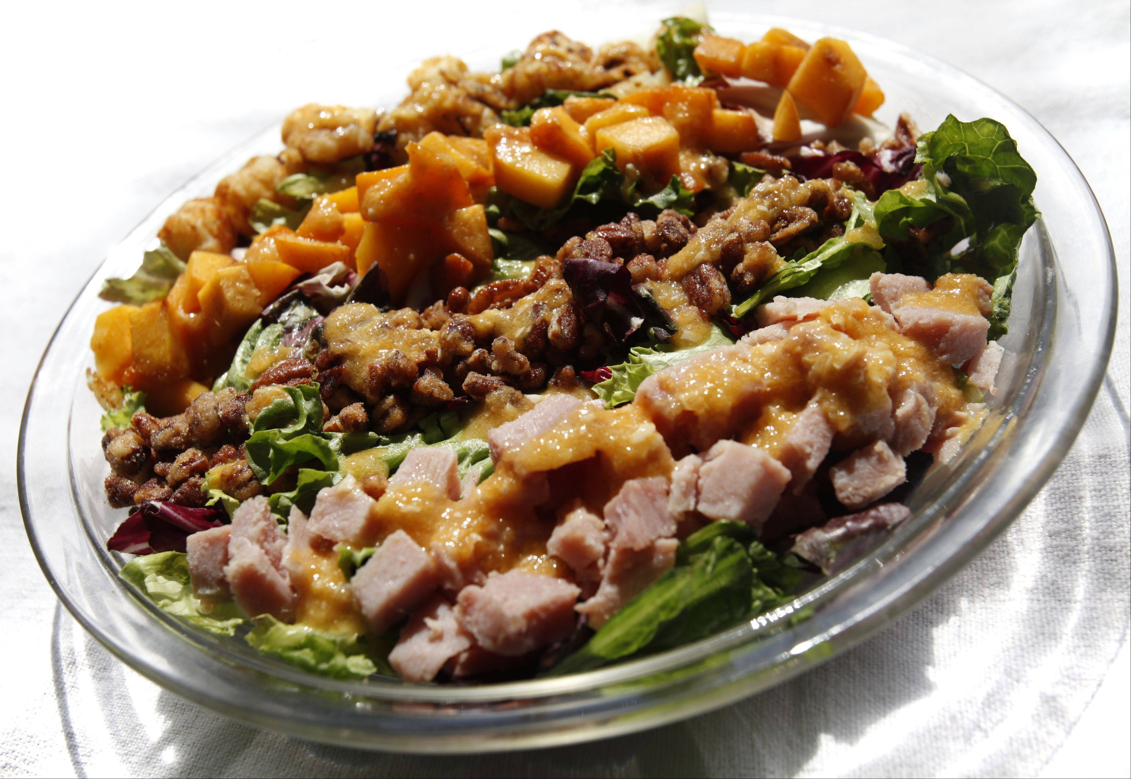 Mary Beth Thornton created a Cobb-style salad with ham, peaches, pecans and tater tots.