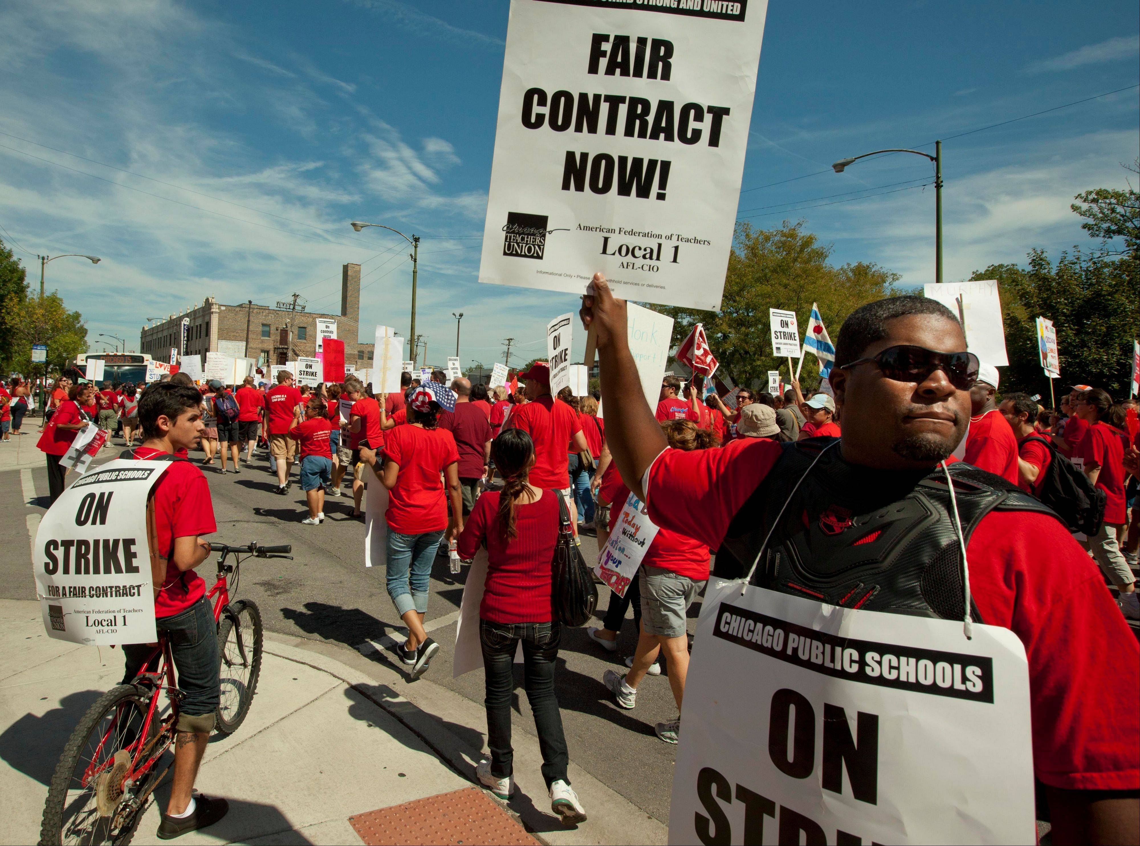 Chicago public school teachers seek support from neighborhood communities Wednesday as they march on streets surrounding John Marshall Metropolitan High School on the West Side.