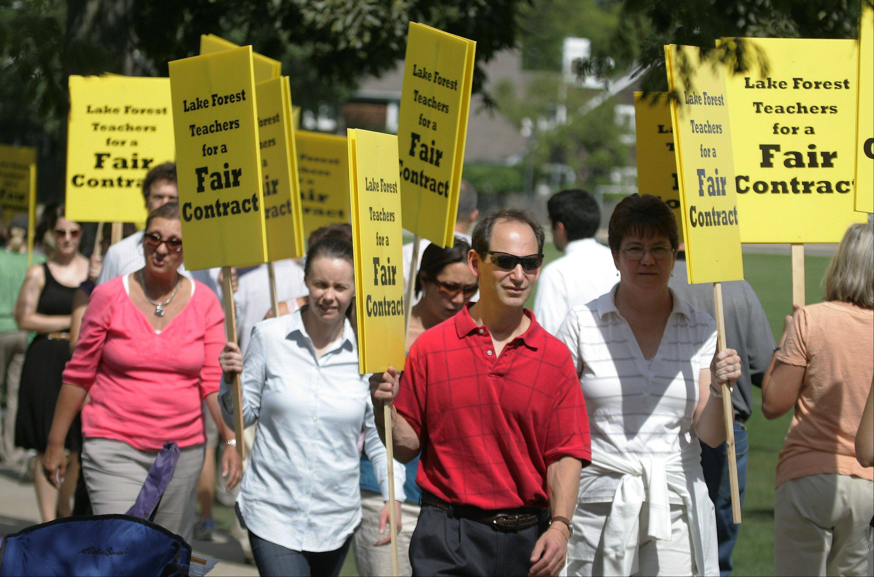 Lake Forest High School teachers picket Wednesday on the first day of their strike over salary and benefits that would be part of a three-year contract.