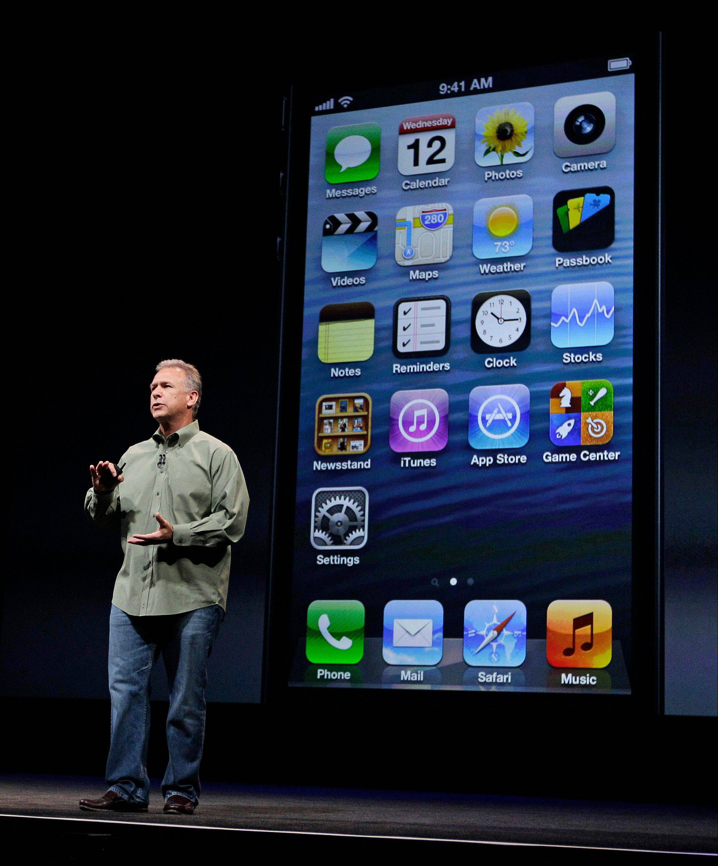 Phil Schiller, Apple's senior vice president of worldwide marketing, speaks on stage during an introduction of the new iPhone 5 at an Apple event in San Francisco, Wednesday Sept. 12, 2012.