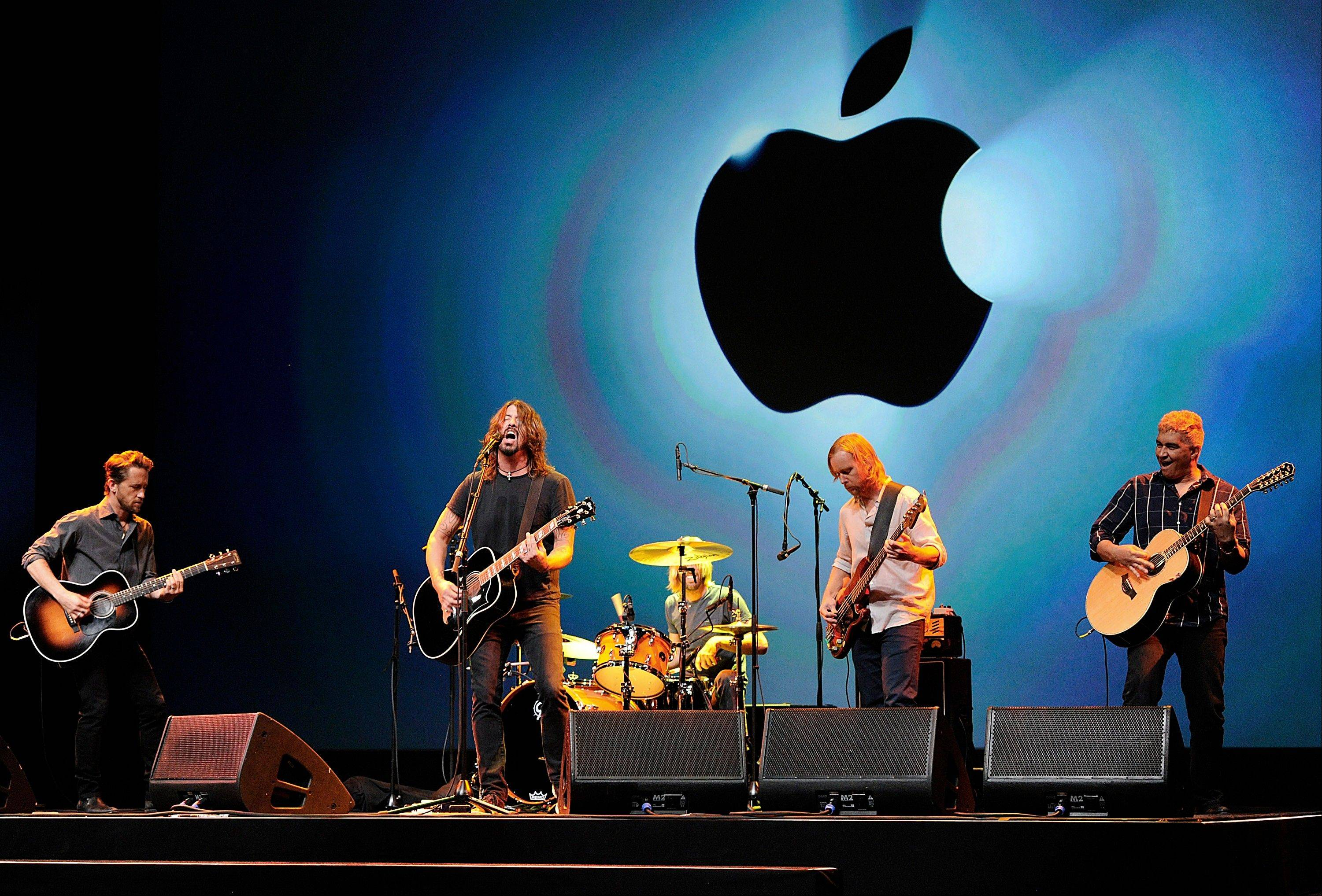 The Foo Fighters perform during an Apple Inc. event in San Francisco, California, U.S., on Wednesday, Sept. 12, 2012.