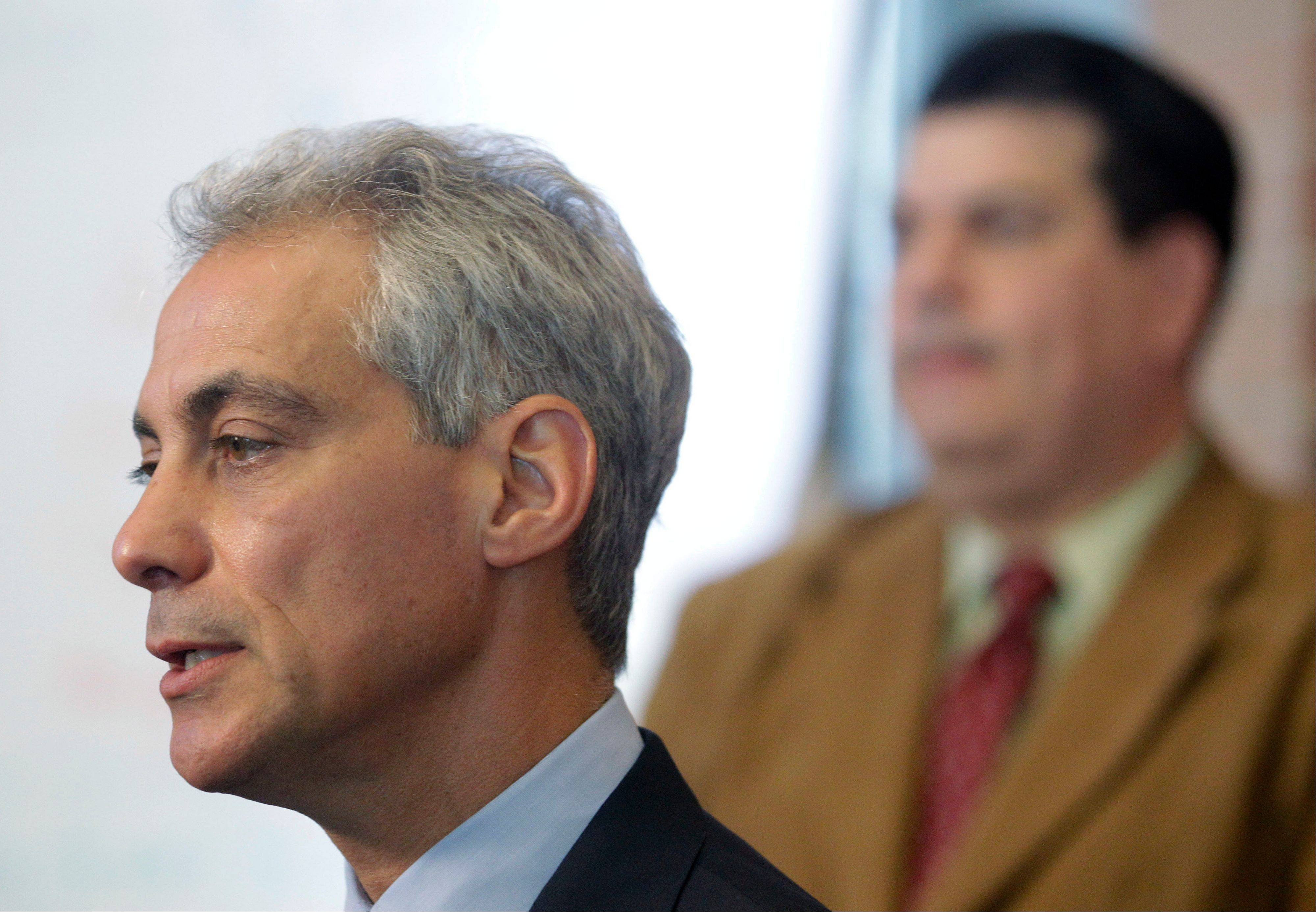 Chicago Mayor Rahm Emanuel speaks during a news conference at Tarkington School of Excellence in Chicago, Tuesday, Sept. 11, 2012 as Vincent Iturralde, right, principal at at Tarkington listens. Negotiations continue on the second day of a strike in the nation's third-largest school district, as the two sides continue to struggle to reach an agreement in a bitter contract dispute over evaluations and job security.