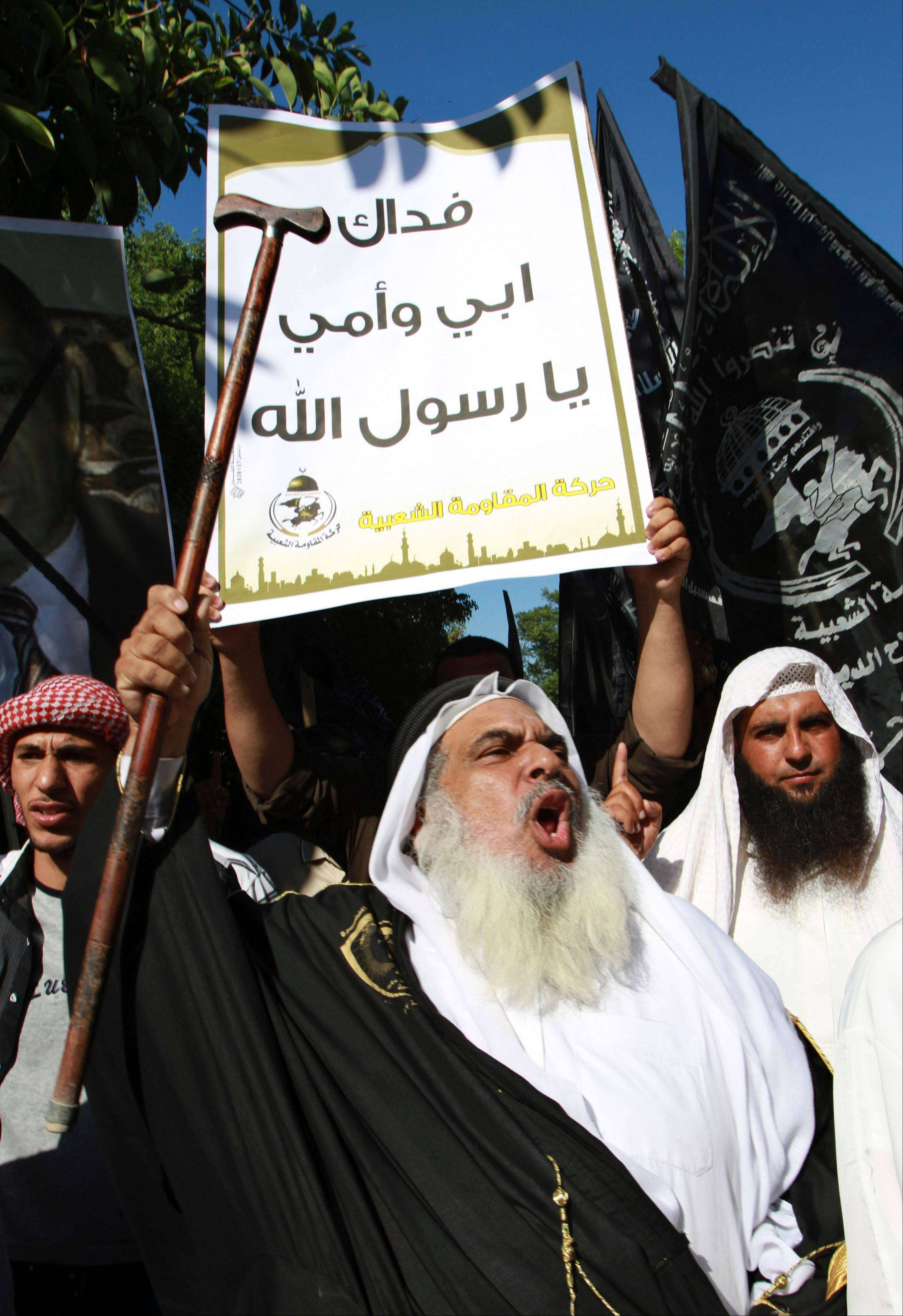 "Palestinians protest against the movie, ""Innocence of Muslims,"" near the United Nations office in Gaza City, Wednesday, Sept. 12, 2012. Muslim anger over perceived Western insults to Islam has exploded several times, most recently in Tuesday's attacks against U.S. diplomatic posts in the Middle East in which U.S. ambassador to Libya Chris Stevens and three other Americans were killed. The banner reads in Arabic ""you are more dear than my father and mother my beloved prophet Mohammed."""