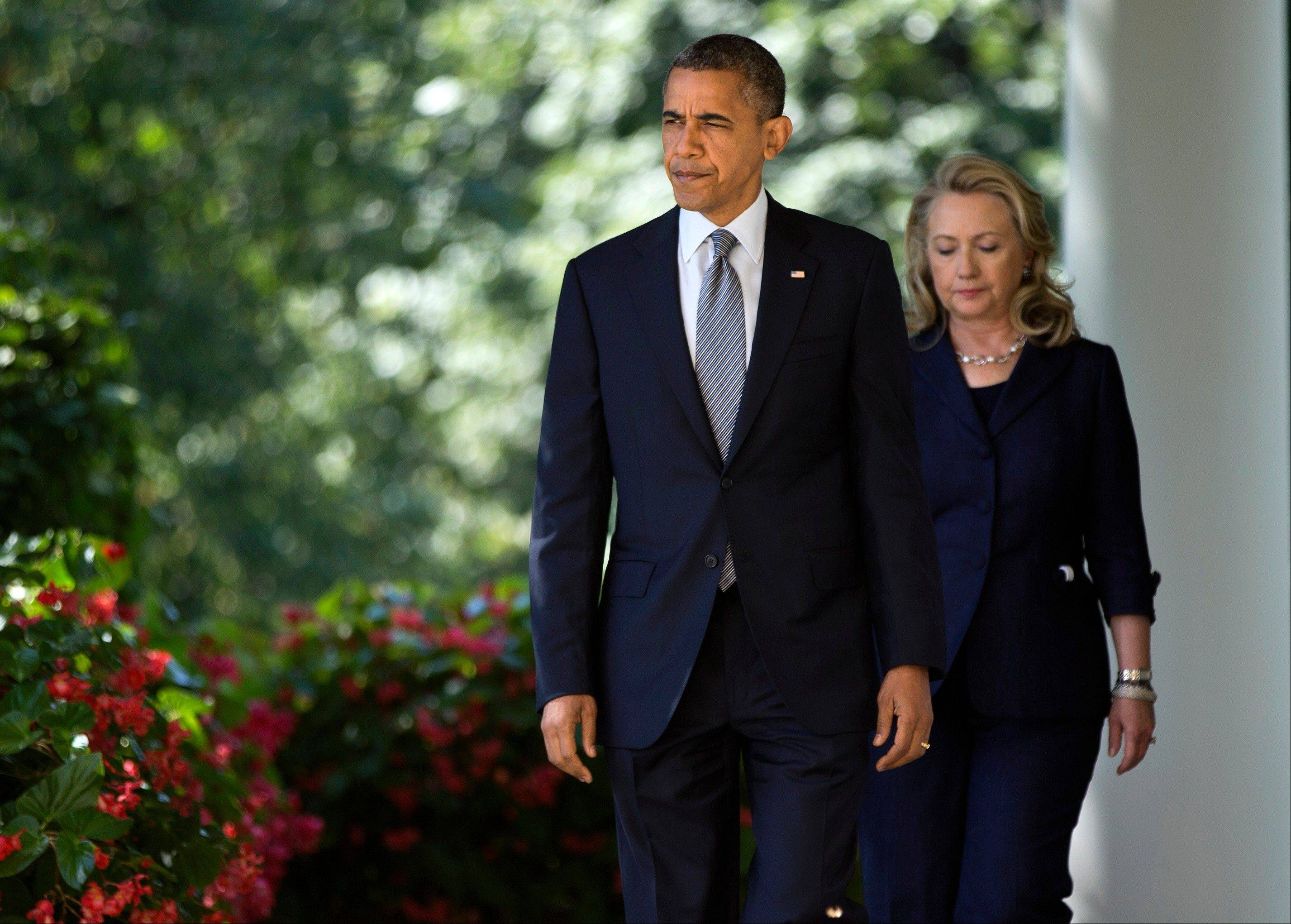 Secretary of State Hillary Clinton follows President Barack Obama to the Rose Garden of the White House in Washington, Wednesday, Sept. 12, 2012, to deliver a statement on the death of U.S. ambassador to Libya Christopher Stevens.