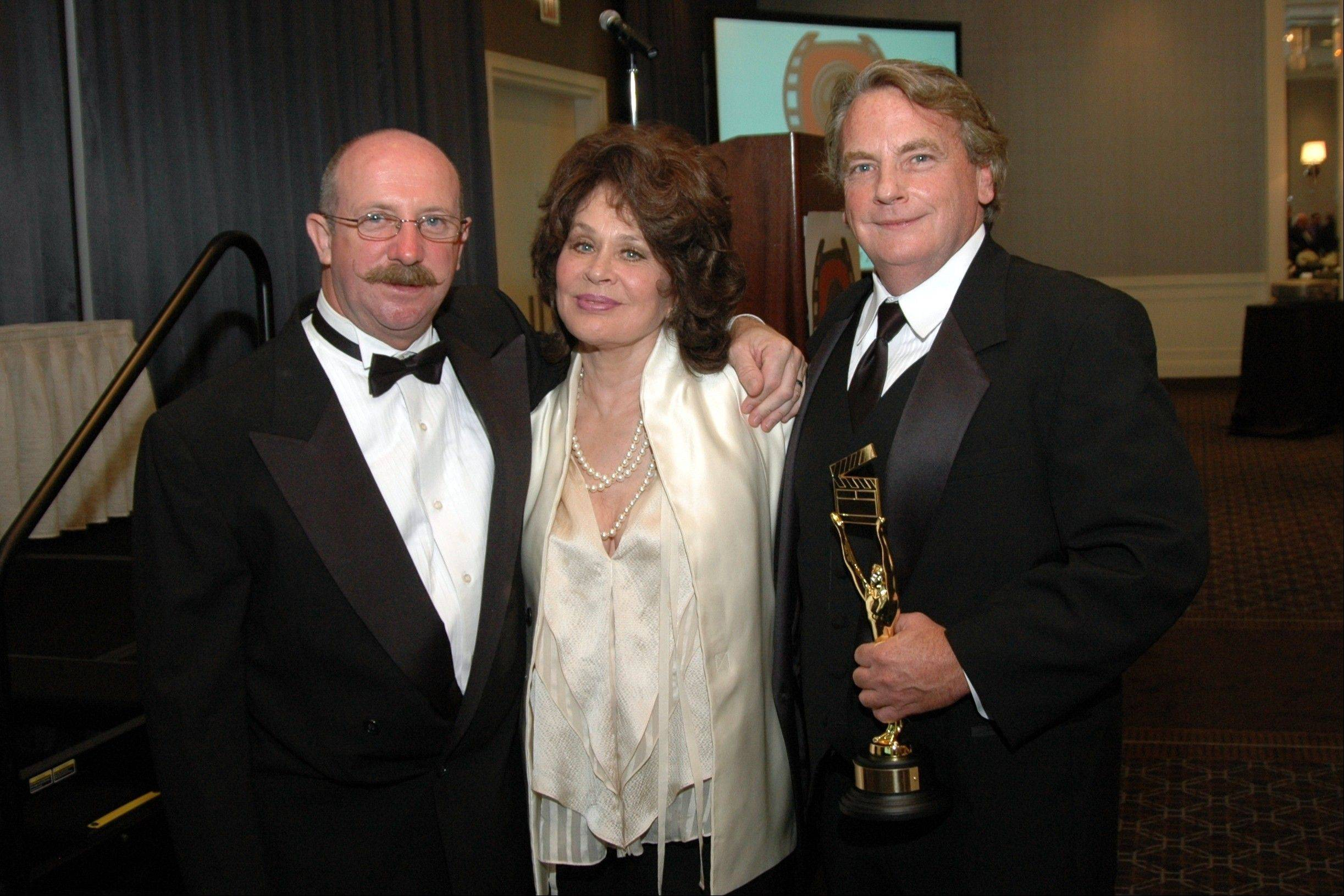 "Edmond Coisson, left, stands with star Karen Black and an award winner at the first Naperville Independent Film Festival. Coisson said he started the festival to give filmmakers exposure. ""Ninety-nine percent of the films we show, you wouldn't see them anywhere else."""