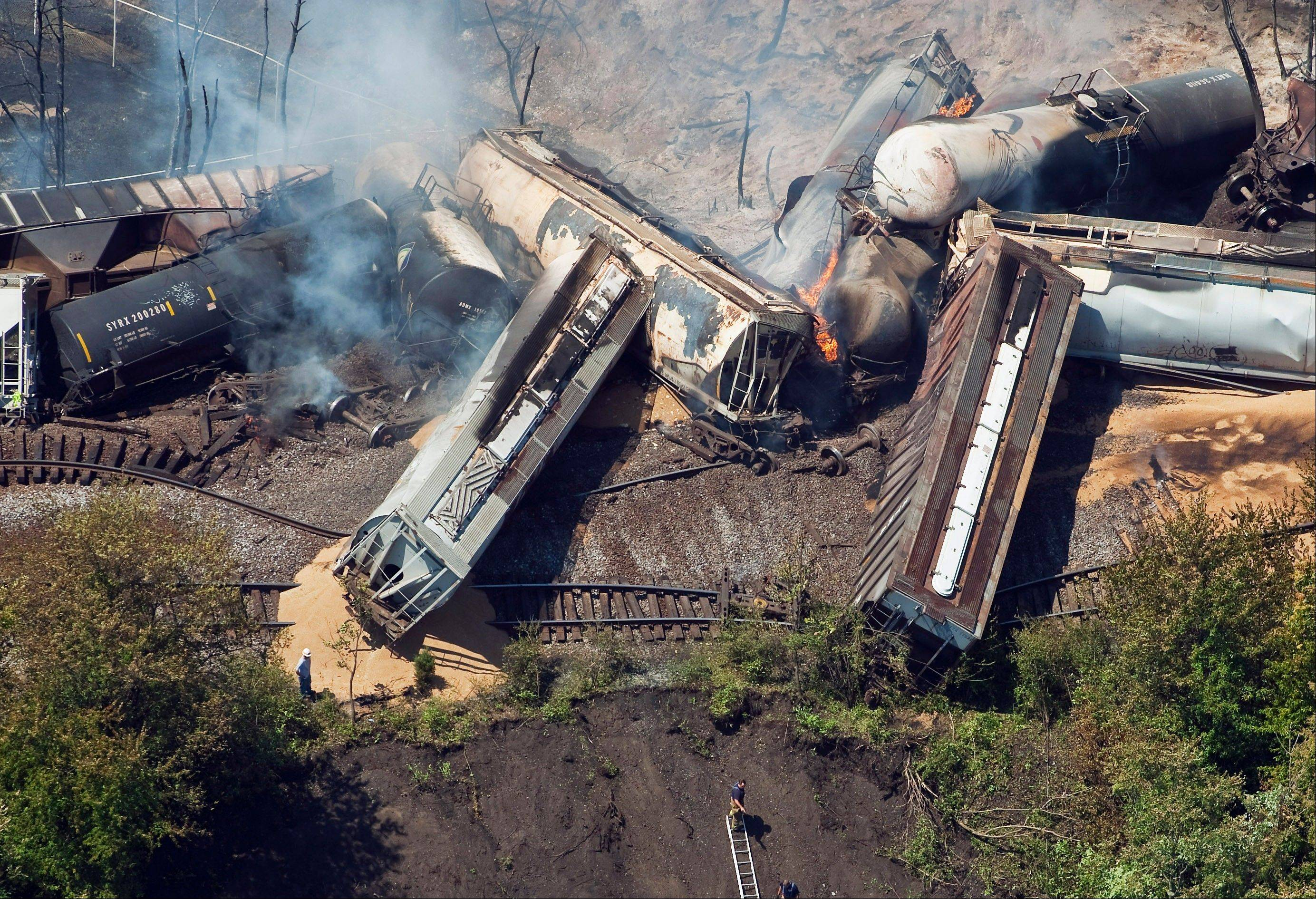 This July 11, 2012 aerial file photo, a freight train is seen after an early morning derailment in Columbus, Ohio. Part of the freight train carrying ethanol derailed and caught fire, shooting flames skyward into the darkness and prompting the evacuation of a mile-wide area as firefighters and hazardous materials crews monitored the blaze.