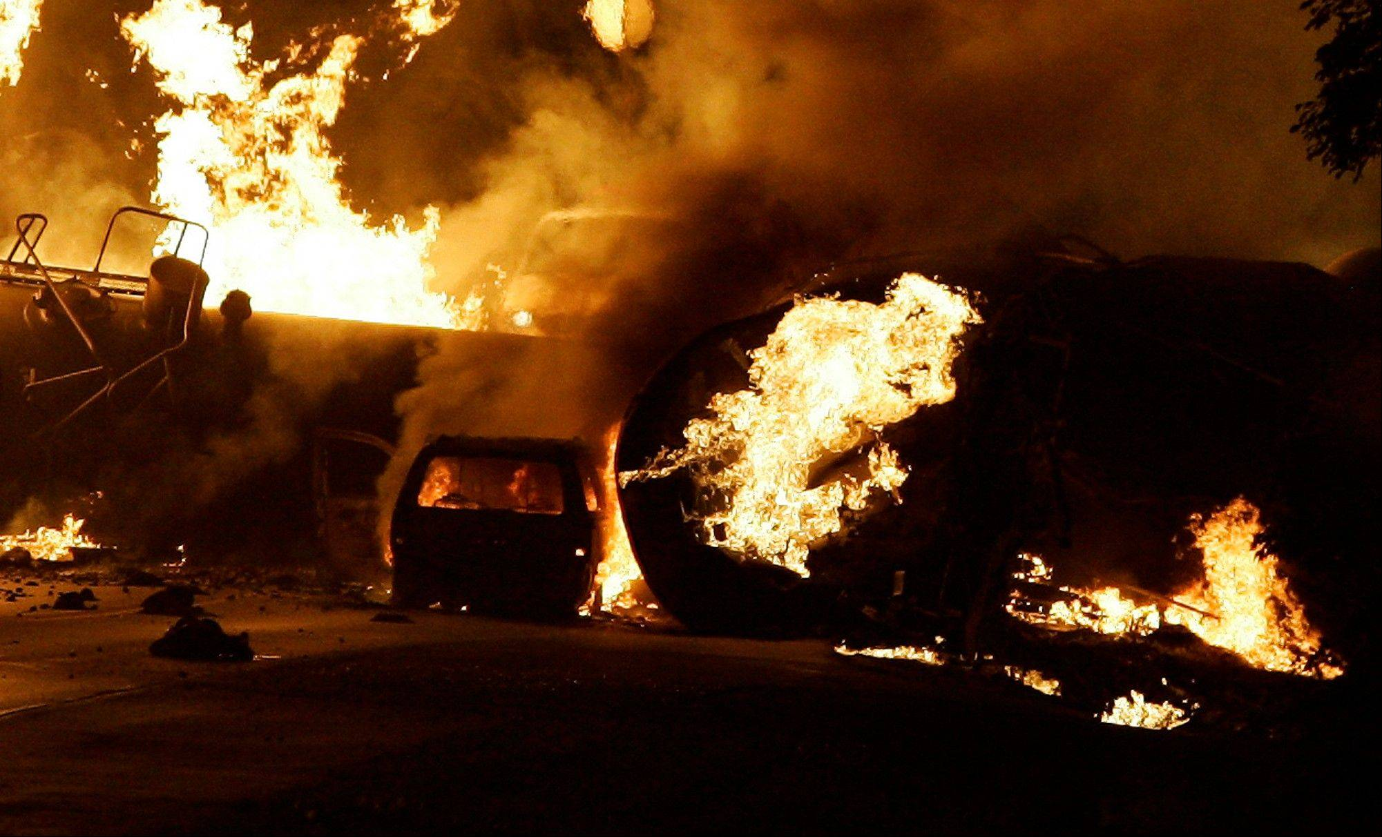 In this June 19, 2009 file photo, a vehicle burns near a train derailment near Rockford, Ill. Residents were forced to evacuate after the fiery freight train derailment northwest of Chicago.