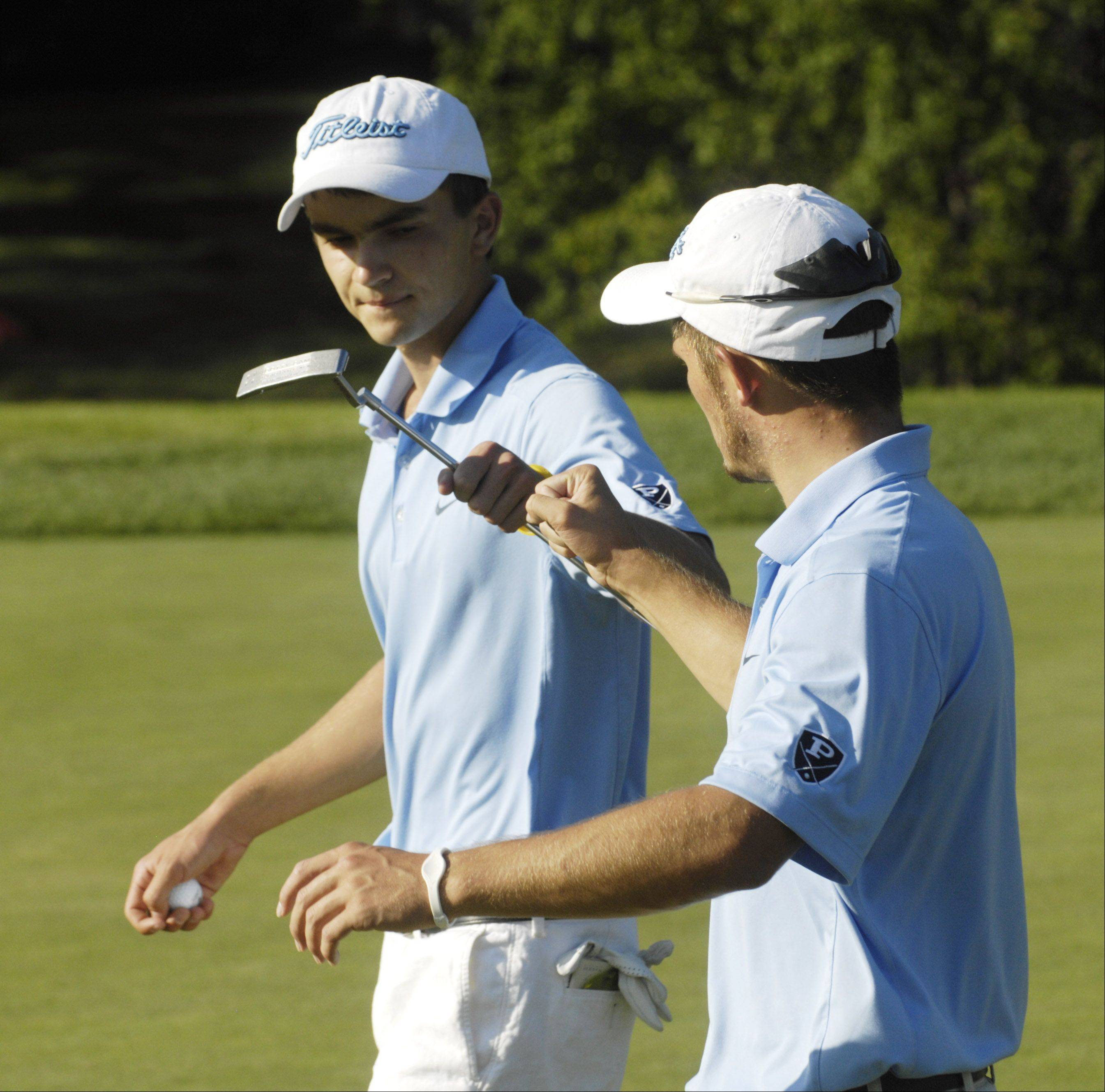 Prospect's Jeff Blethen, left, and Josh Johnson congratulate one another for their efforts on the fifth hole while competing against Barrington at Makray Memorial Golf Course in Barrington on Wednesday.