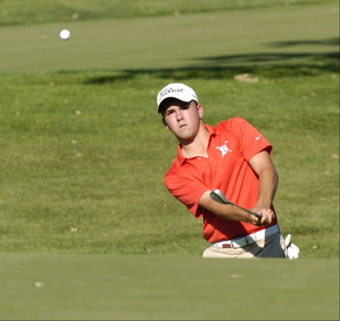 Barrington's Greg Conrad chips onto the green on the fourth hole while competing against Prospect at Makray Memorial Golf Course in Barrington on Wednesday.