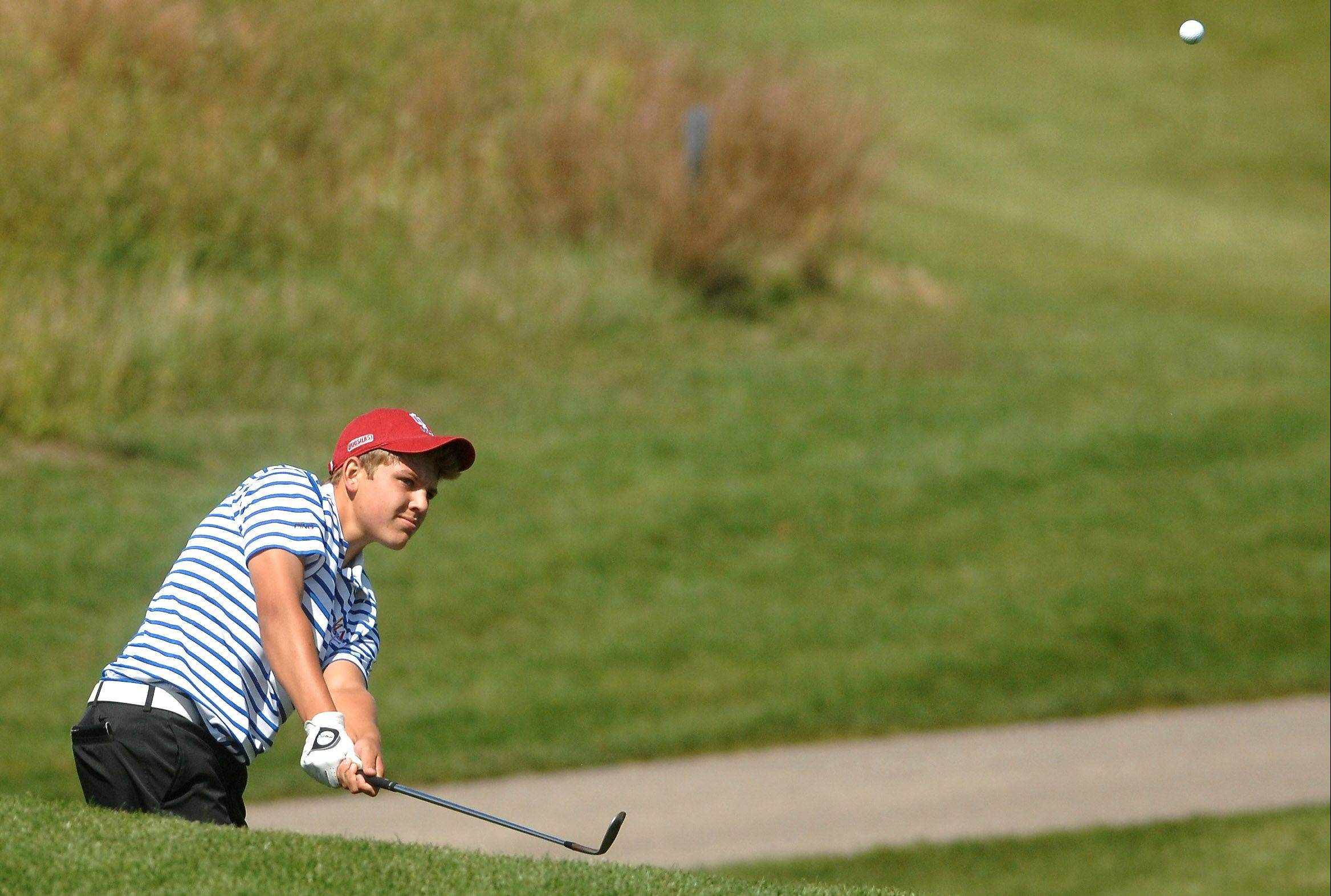 Marmion's Liam Creamer chips onto the green on the second hole during the Aurora boy's golf invite at Phillips Park Wednesday.