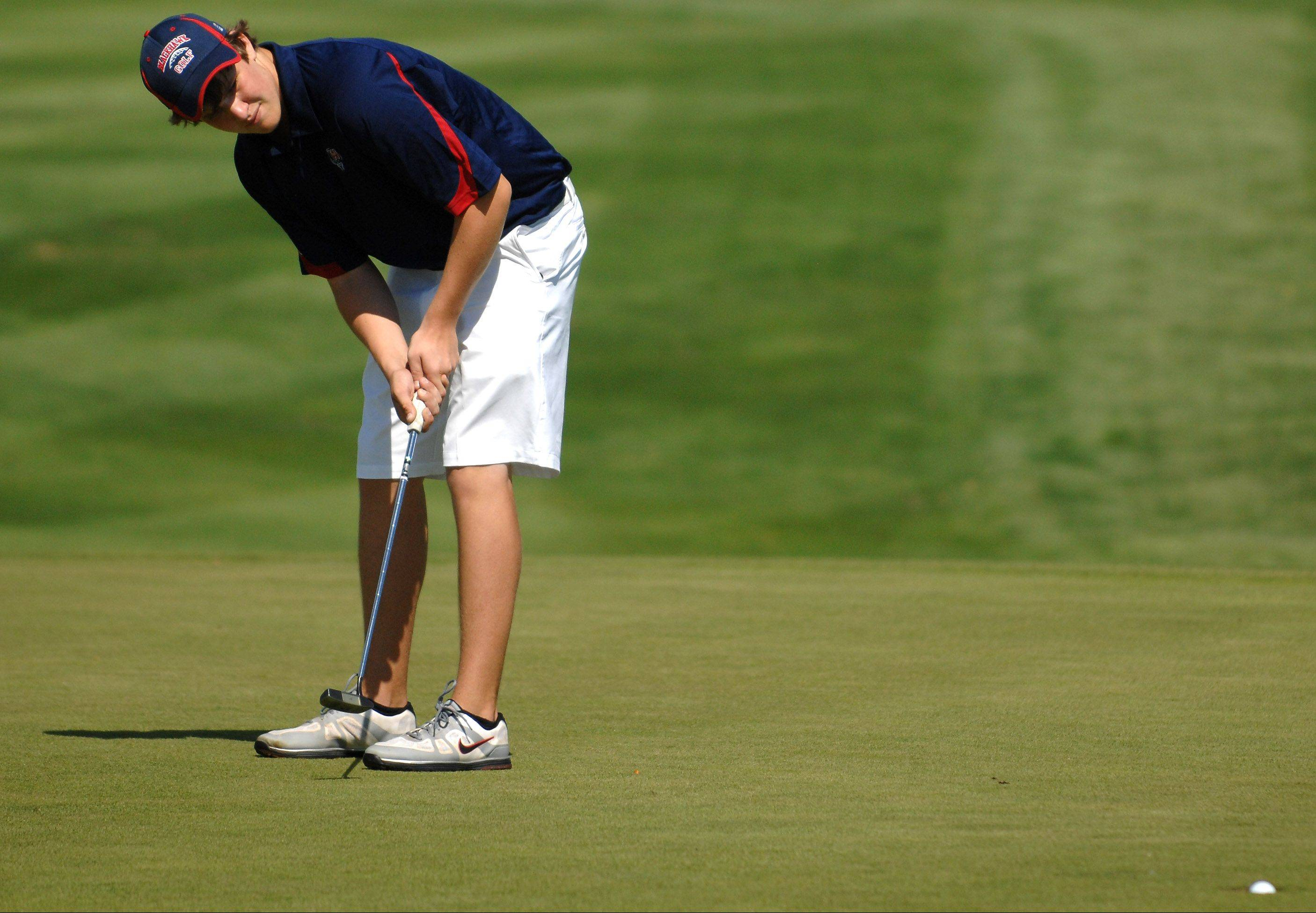West Aurora's Blake Kauffmann watches his putt drop.
