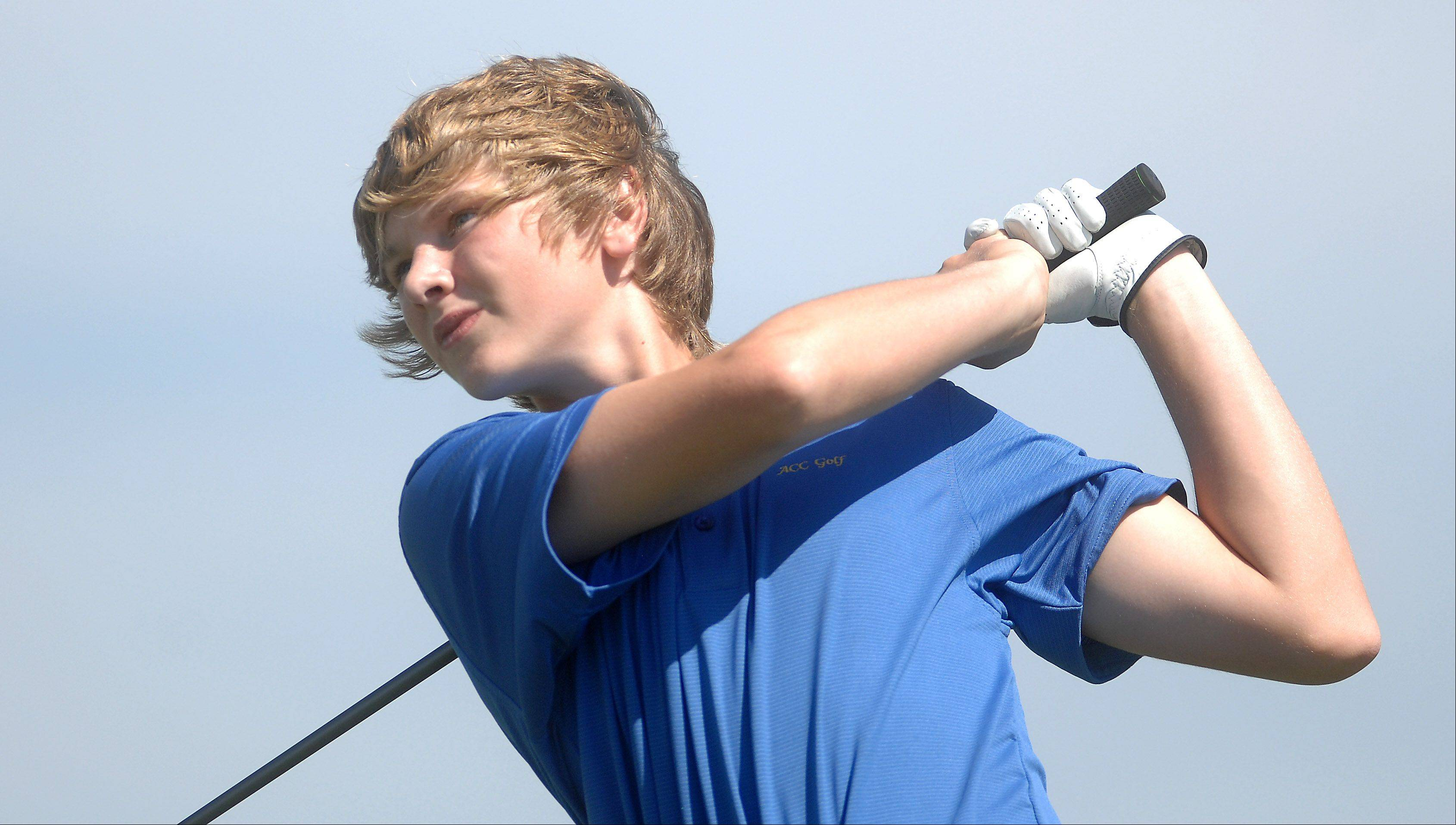Aurora Central Catholic's Sean Harreld tees off on the third hole.