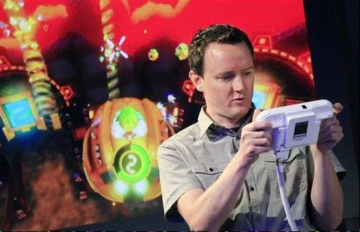 Nintendo�s Bill Trinen demonstrates the Wii U GamePad. The gaming console will start at $300 and go on sale in the U.S. on Nov. 18, in time for the holidays, the company said Thursday.