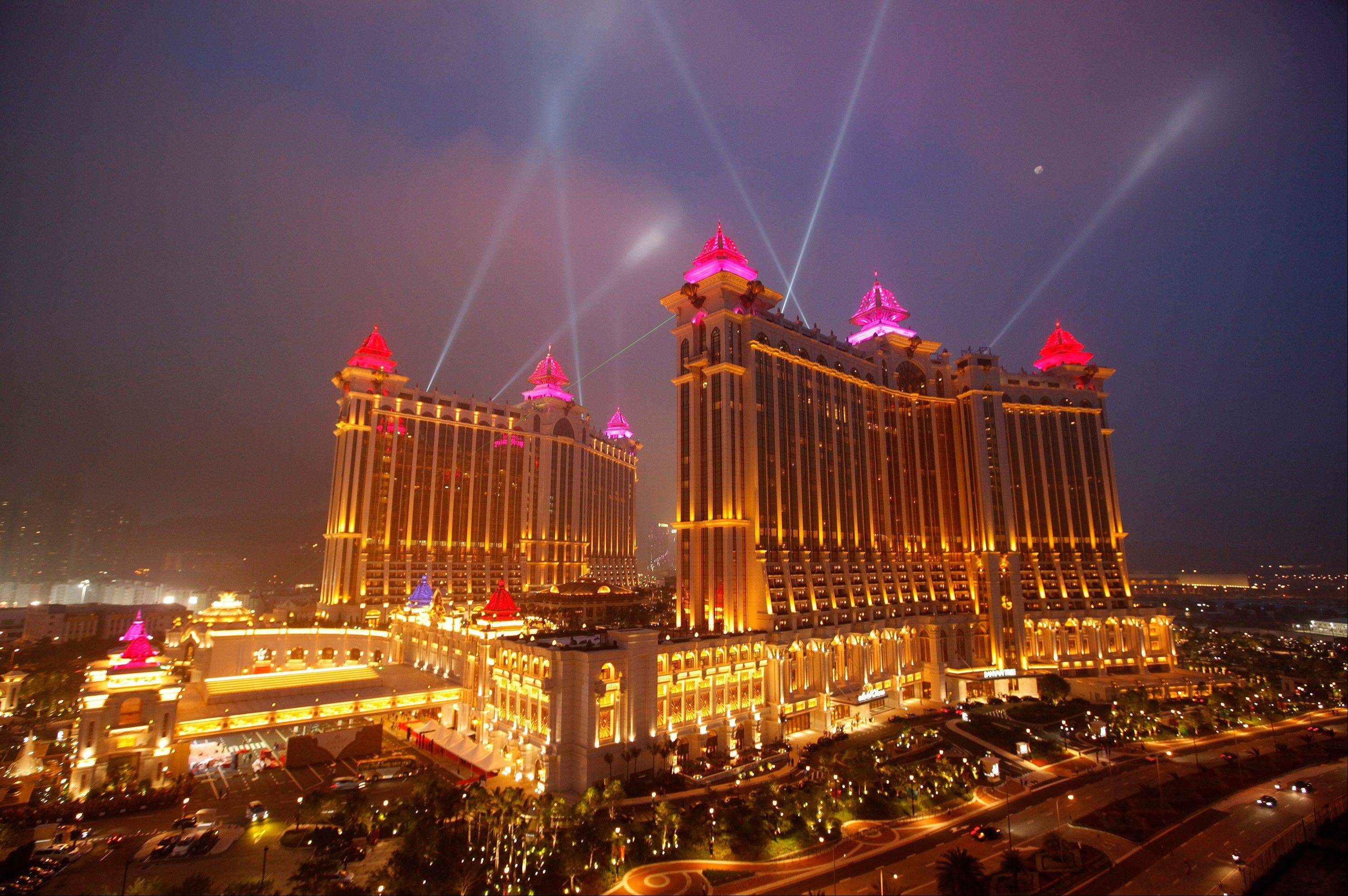 In this May 15, 2011 file photo, the complex of Galaxy Macau is illuminated in Macau. In the Philippines, a $4-billion casino project will soon rise from reclaimed land on Manila Bay. In South Korea, foreign investors are scheduled to break ground next year on a clutch of casino resorts offshore.