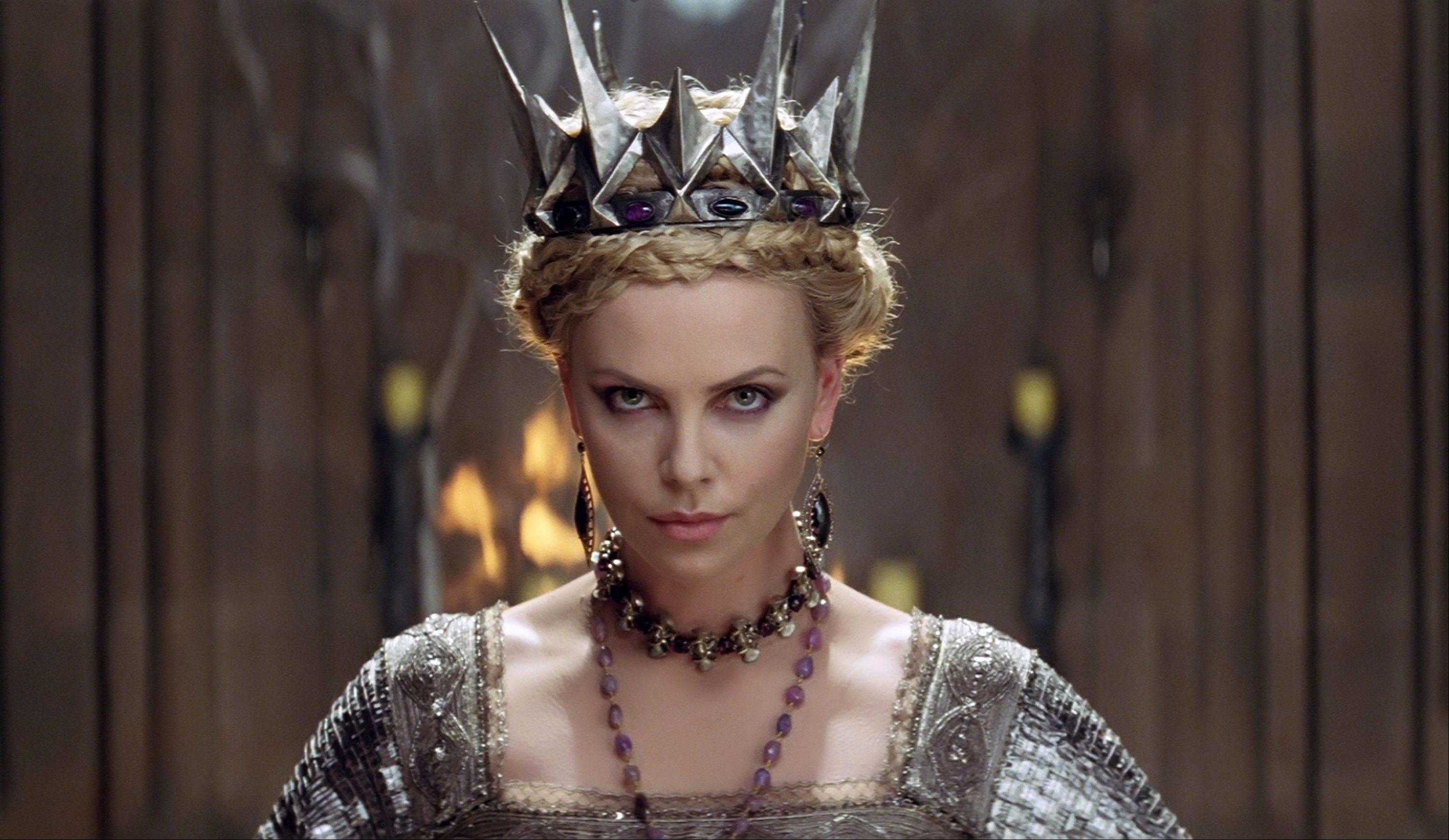"An evil queen (Charlize Theron) plots against her stepdaughter in ""Snow White and the Huntsman."""