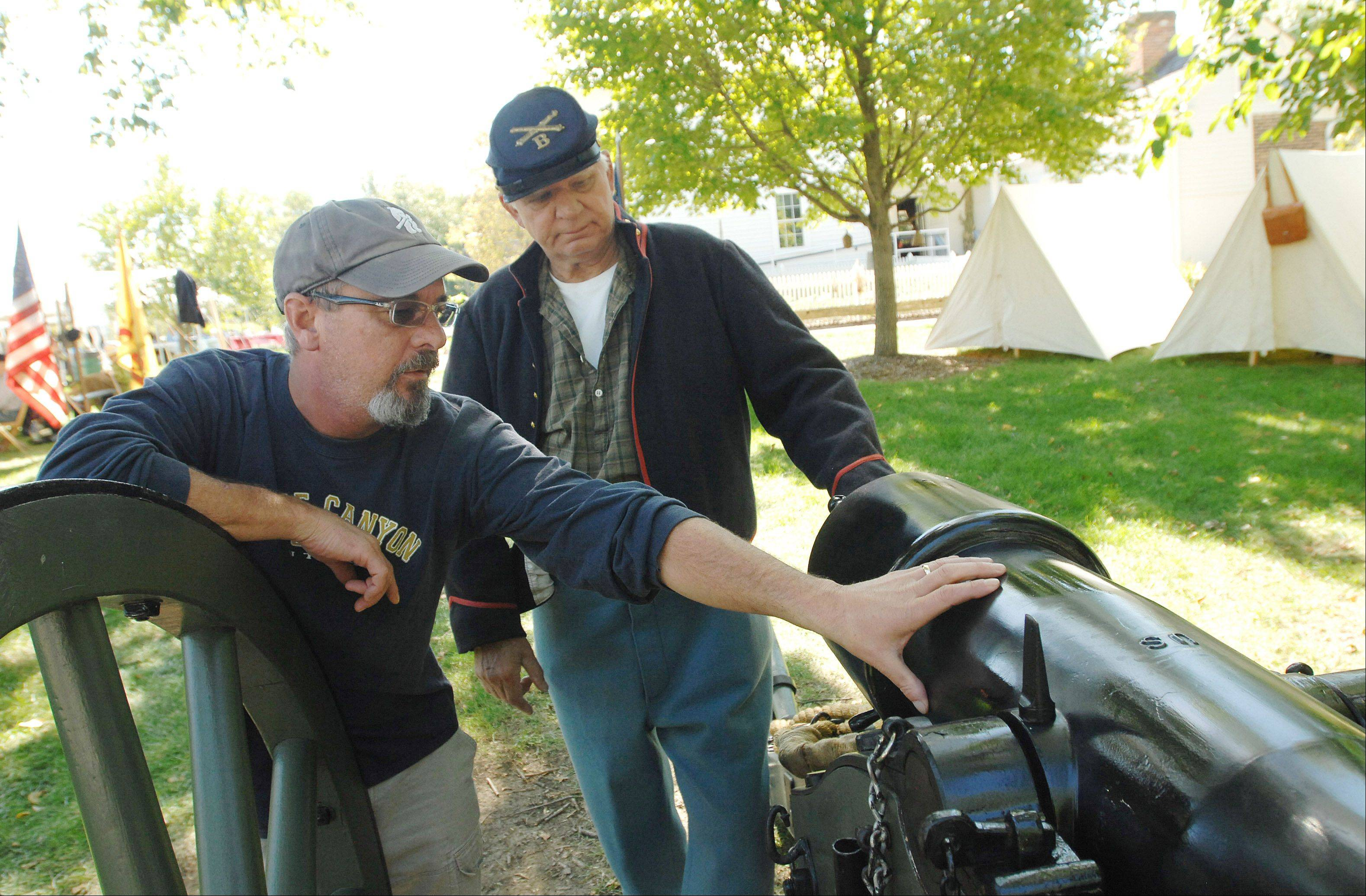 Re-enactor Claude Pagacz of Elmhurst explains a Civil War-era cannon to Matt Fink of Naperville on Saturday during Depot Days in Lisle.