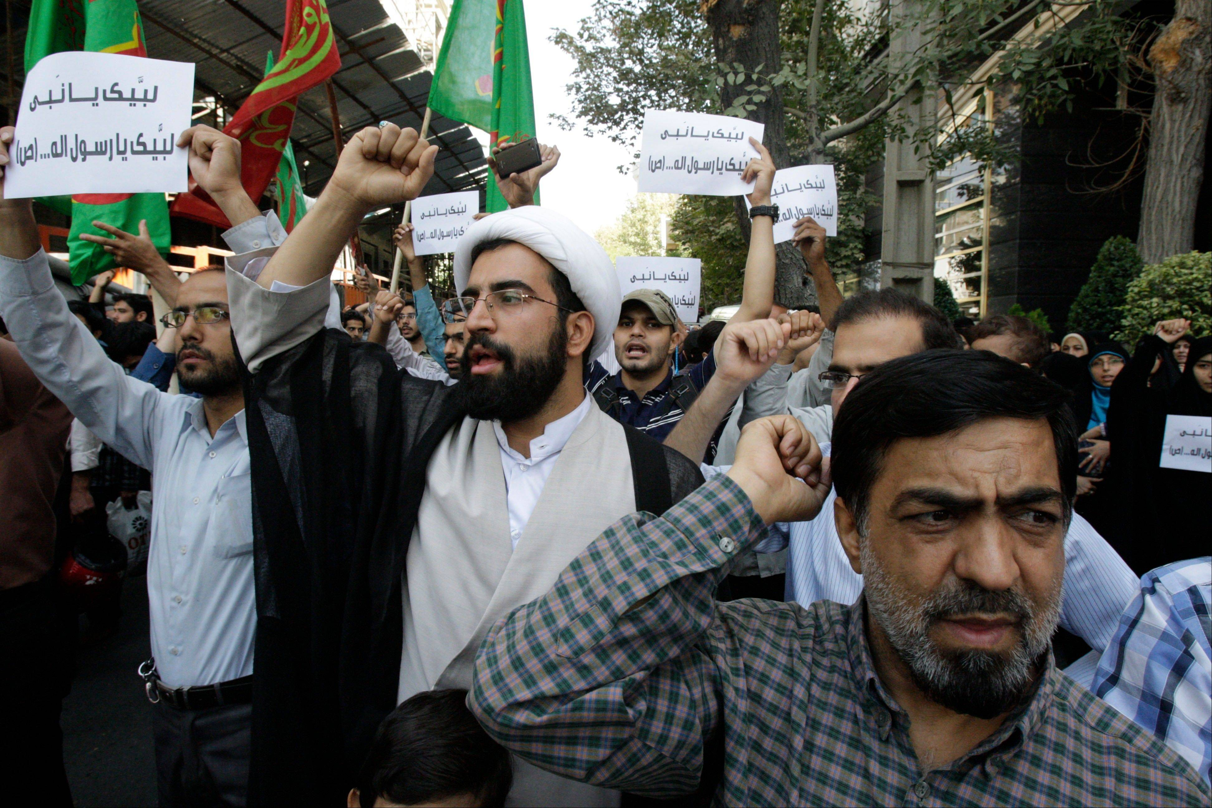 Iranian protestors chant slogans Thursday during a demonstration against a film ridiculing Islam�s Prophet Muhammad, in front of Swiss Embassy in Tehran.