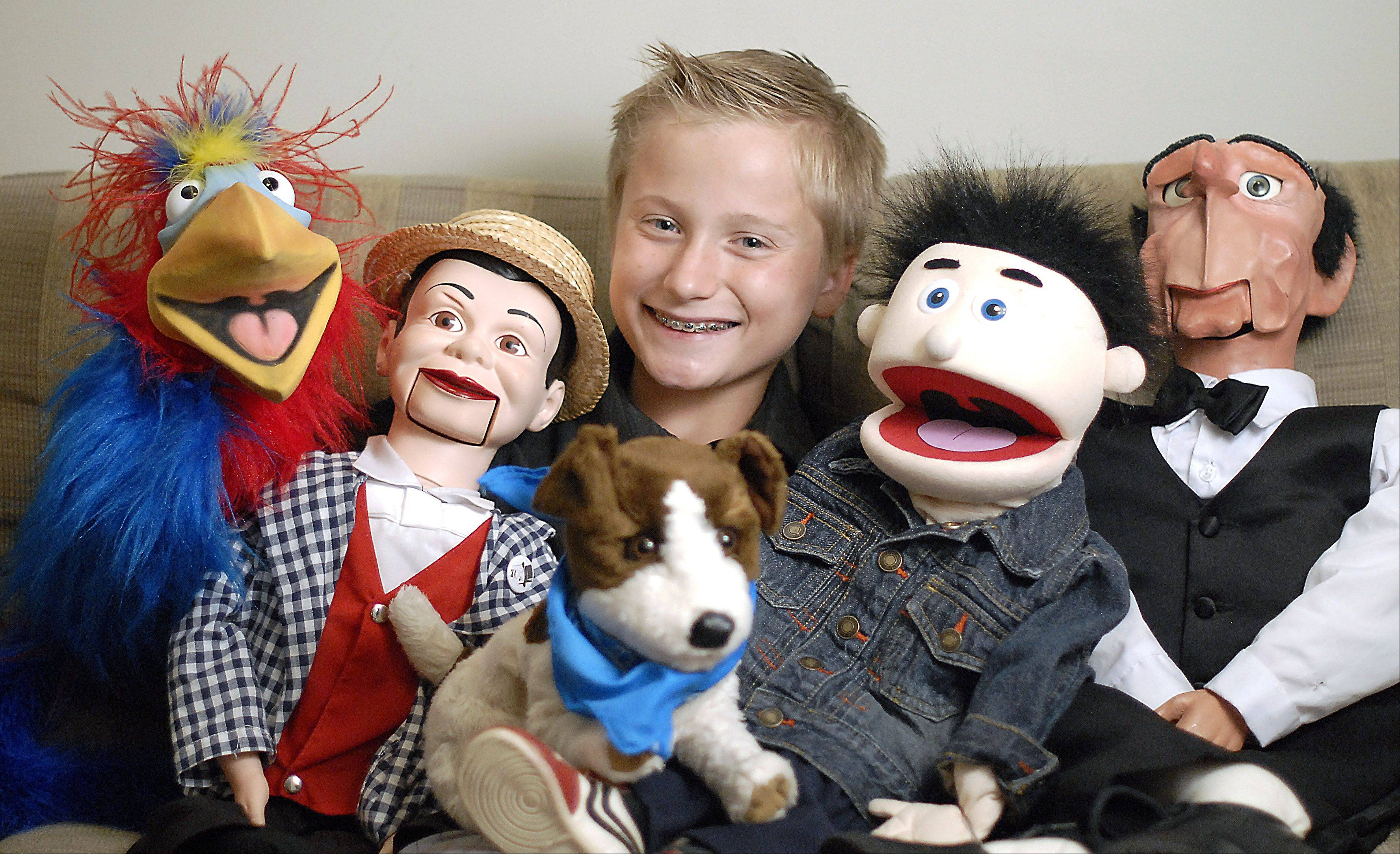 Twelve-year-old ventriloquist Noah Simmons of Huntley and his five characters, from left: Steve the parrot, Charles, Buster the dog, Dylan and Sidney.