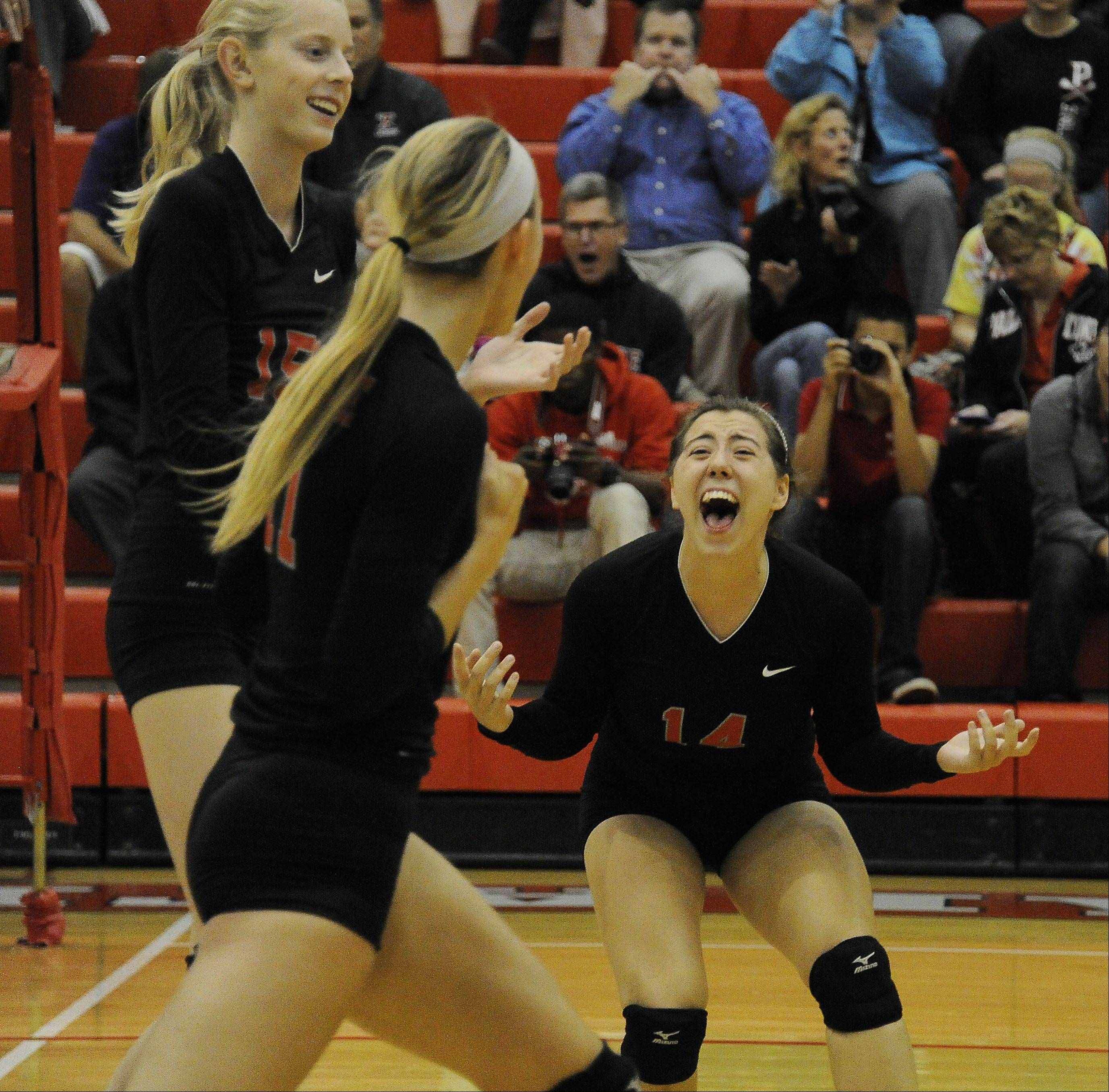 Palatine�s Sarah Schiffner celebrates a point near the end of set one during the Pirates� victory over visiting Fremd on Thursday.