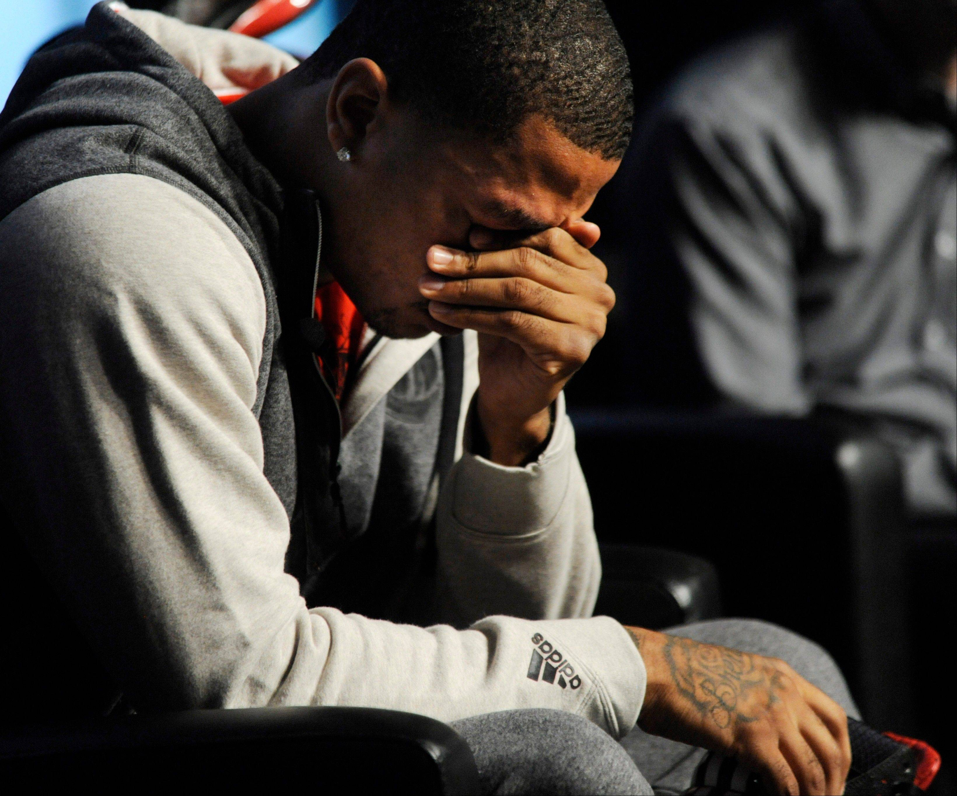 Bulls guard Derrick Rose breaks down and cries Thursday during a news conference unveiling his new shoe the Adidas D Rose 3.