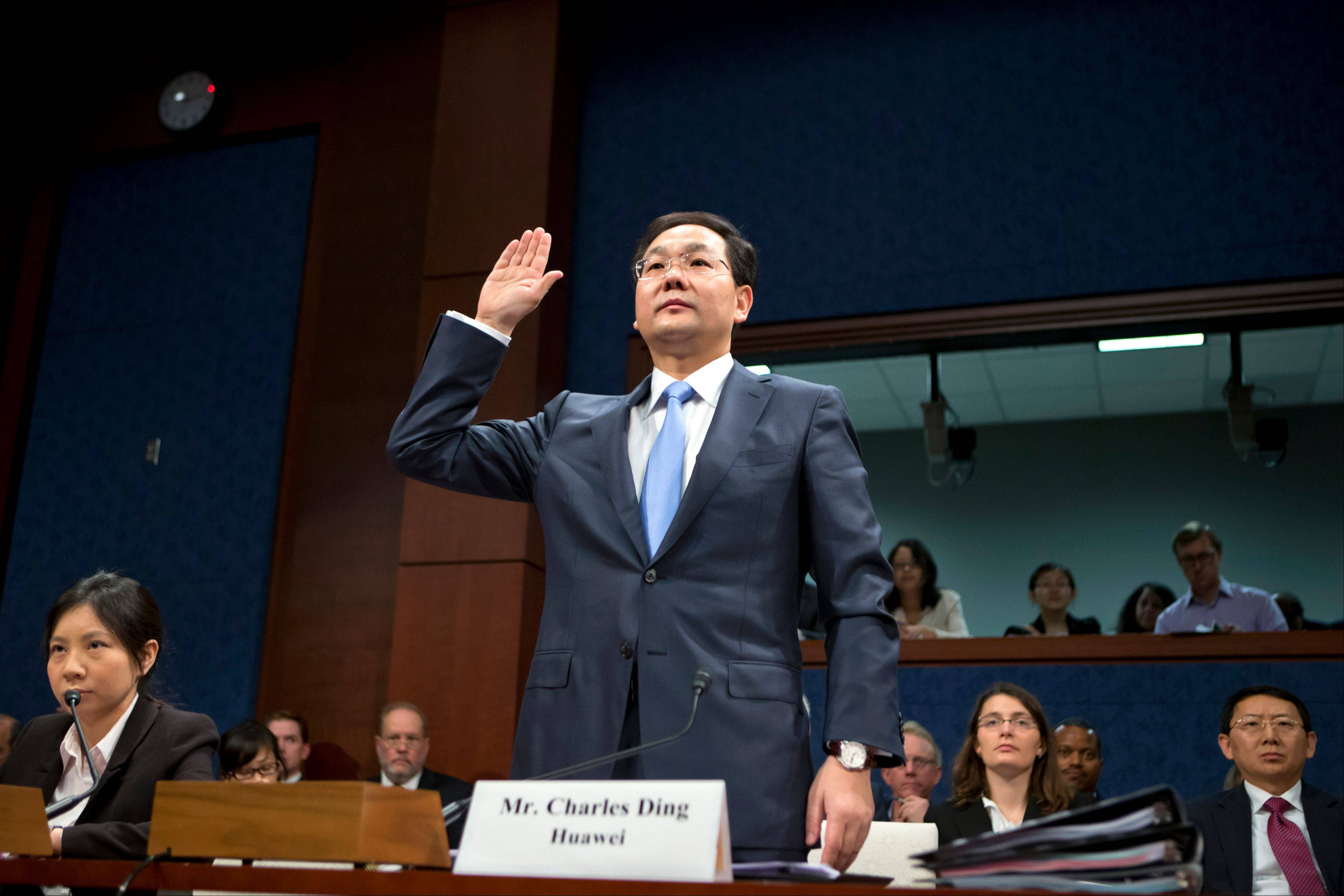 Charles Ding, Huawei Technologies Ltd's senior vice president for the U.S., is sworn in on Capitol Hill in Washington, Thursday, Sept. 13, 2012, prior to testifying before the House Intelligence Committee as lawmakers probe whether Chinese tech giants' expansion in the U.S. market pose a threat to national security.