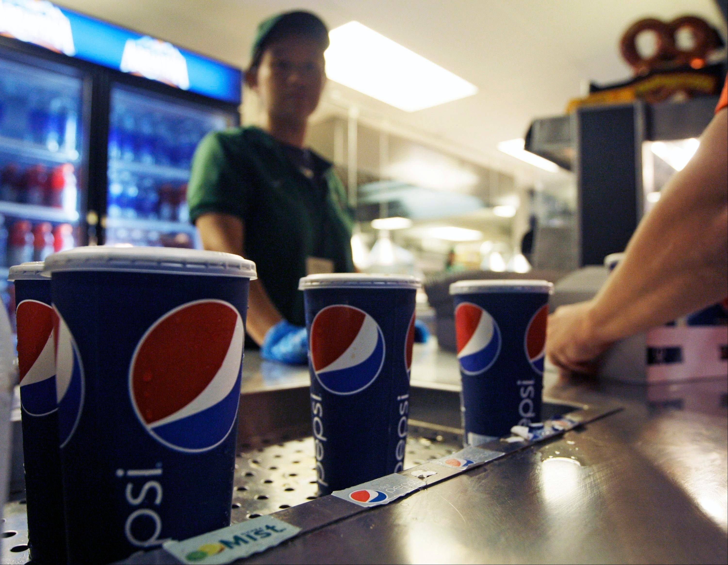 Soft drinks are on display Wednesday during a baseball game between the New York Mets and the Washington Nationals. Health officials approved an unprecedented 16-ounce limit on sodas and other sugary drinks.