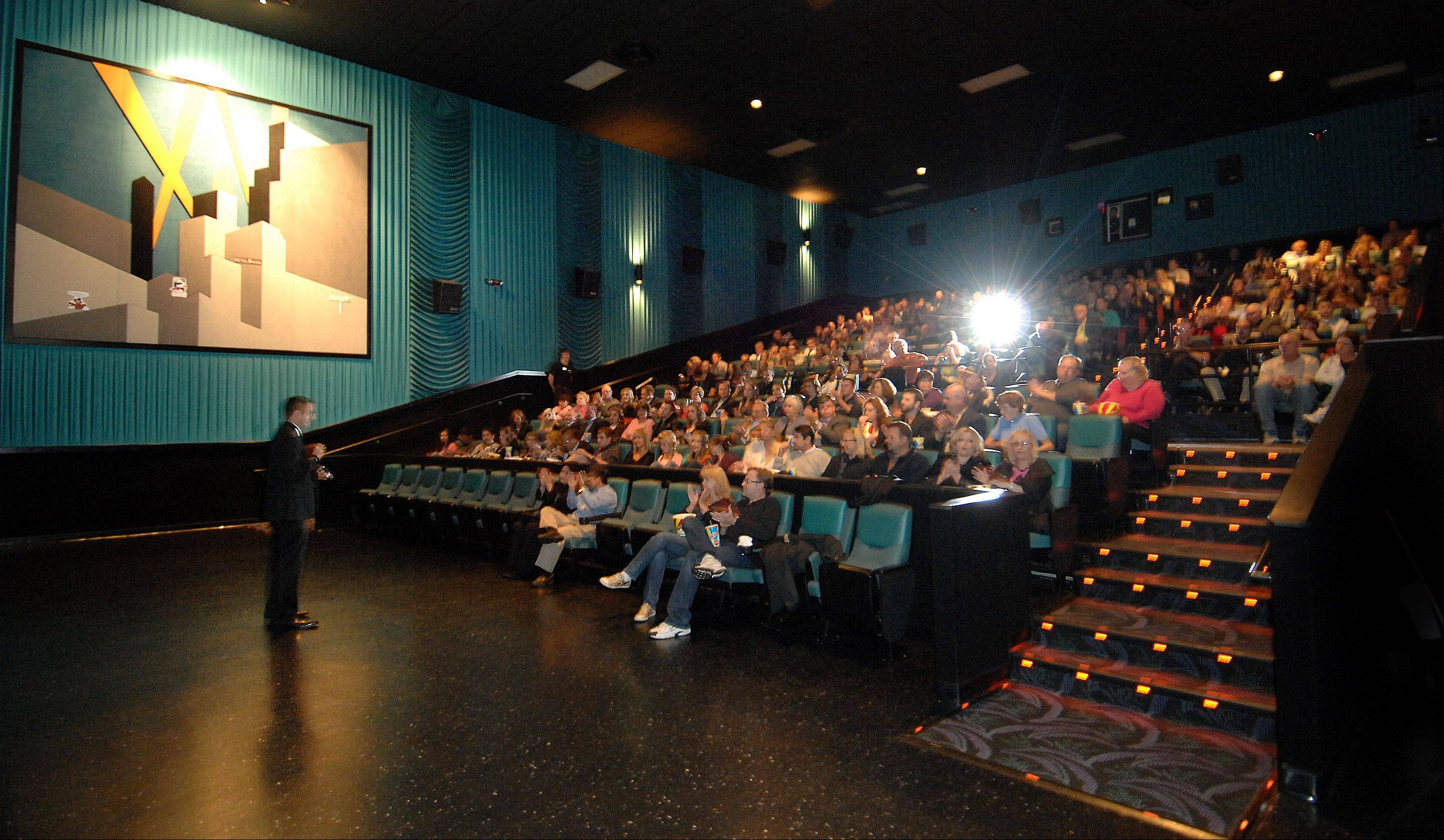 "Nicholas Smith speaks to the audience before the private premiere of his film ""Munger Road"" last year at Charlestowne 18 in St. Charles."