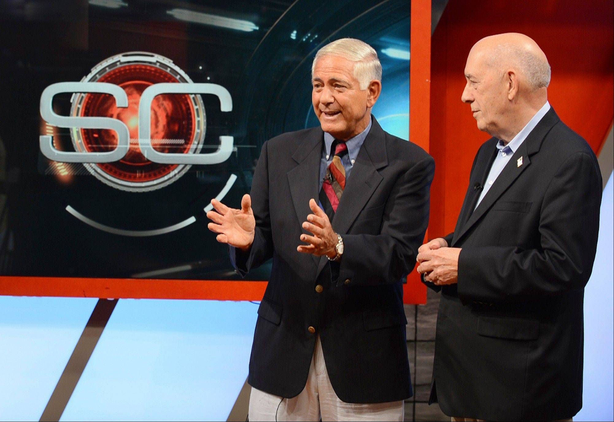 Original SportsCenter host George Grande, left, and ESPN founder Bill Rasmussen promote the 50,000th episode of SportsCenter, which will air Thursday.