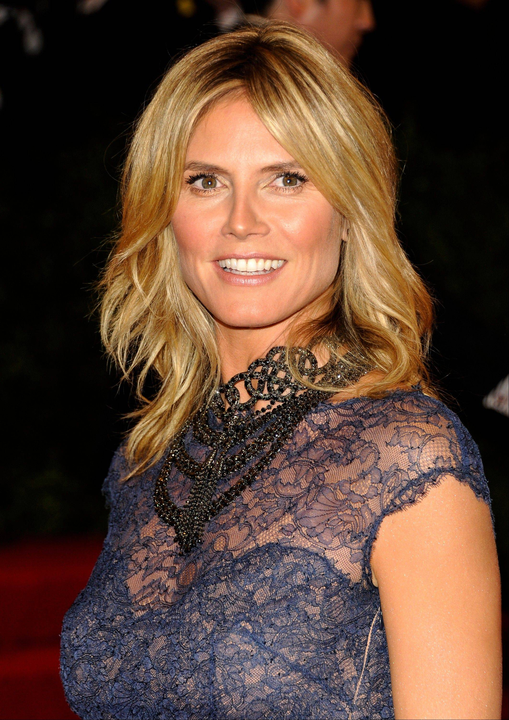 Model and TV host Heidi Klum is denying that she had an affair with her bodyguard while married to pop singer Seal. But now, having split from Seal, she says she is seeing the bodyguard.