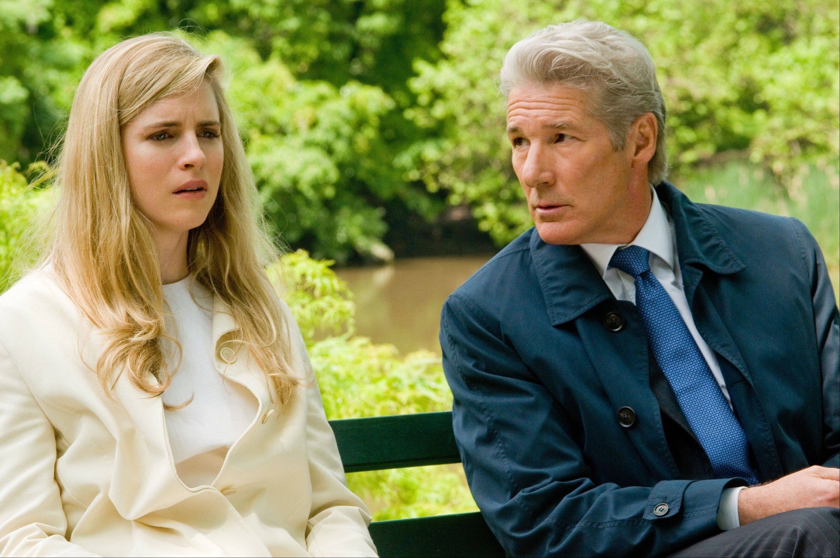 "Brooke (Brit Marling) confronts her financier father (Richard Gere) about missing funds in the capitalistic thriller ""Arbitrage."""