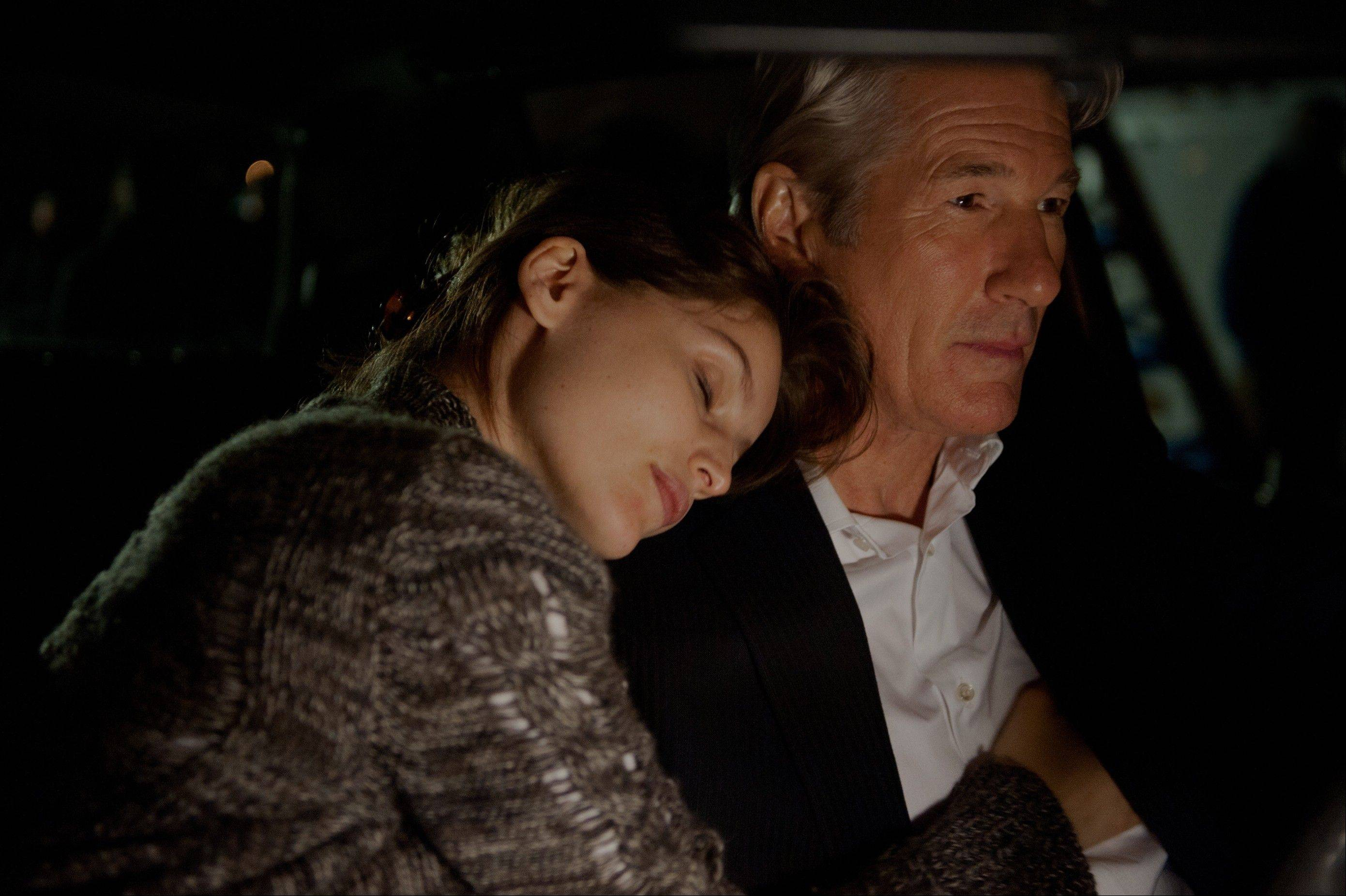 "Julie (Laetitia Casta) shares a romantic moment with her adulterer lover (Richard Gere) just before a tragedy in the capitalistic thriller ""Arbitrage."""