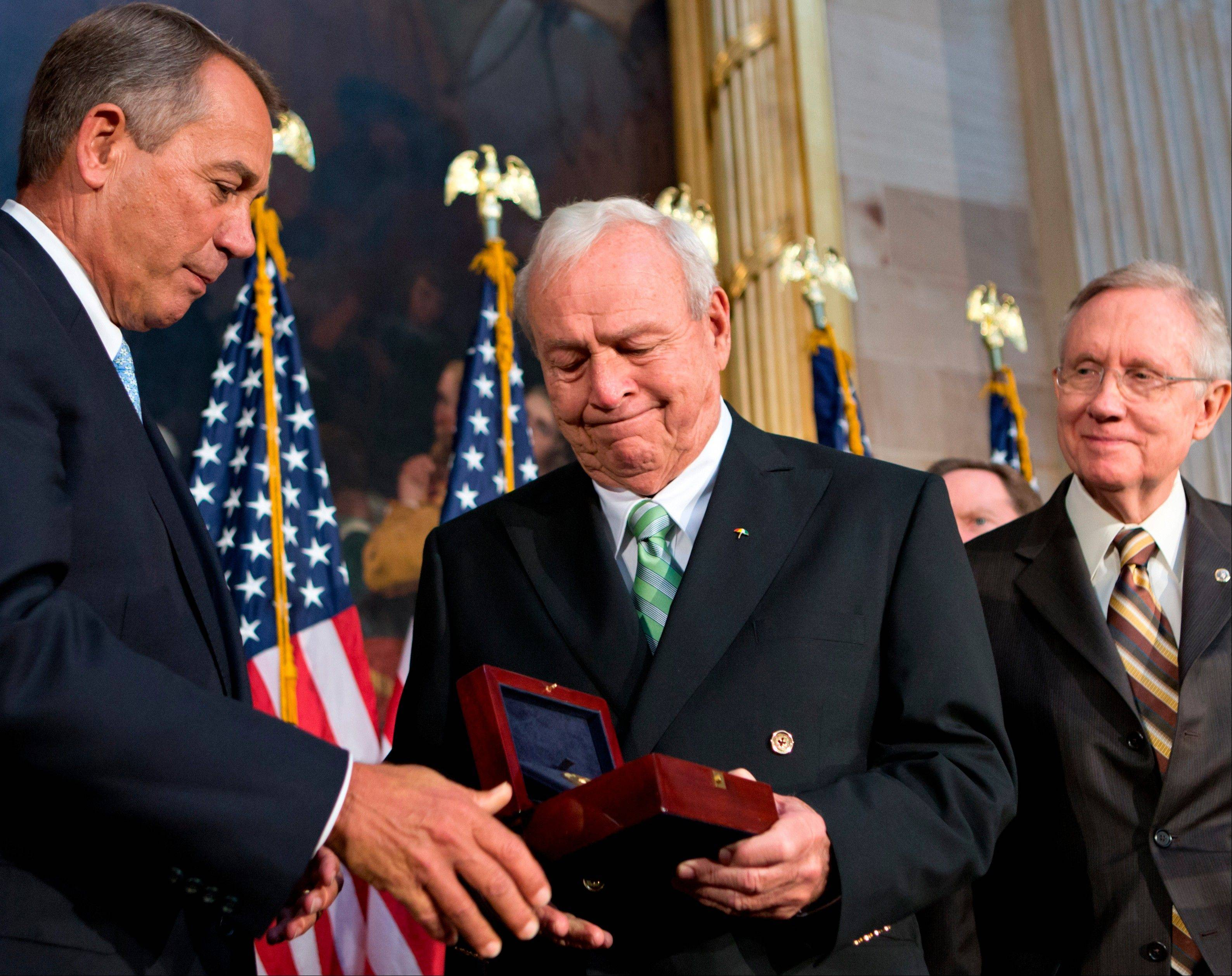 Golfing great Arnold Palmer, center, receives the Congressional Gold Medal Wednesday from House Speaker John Boehner of Ohio.