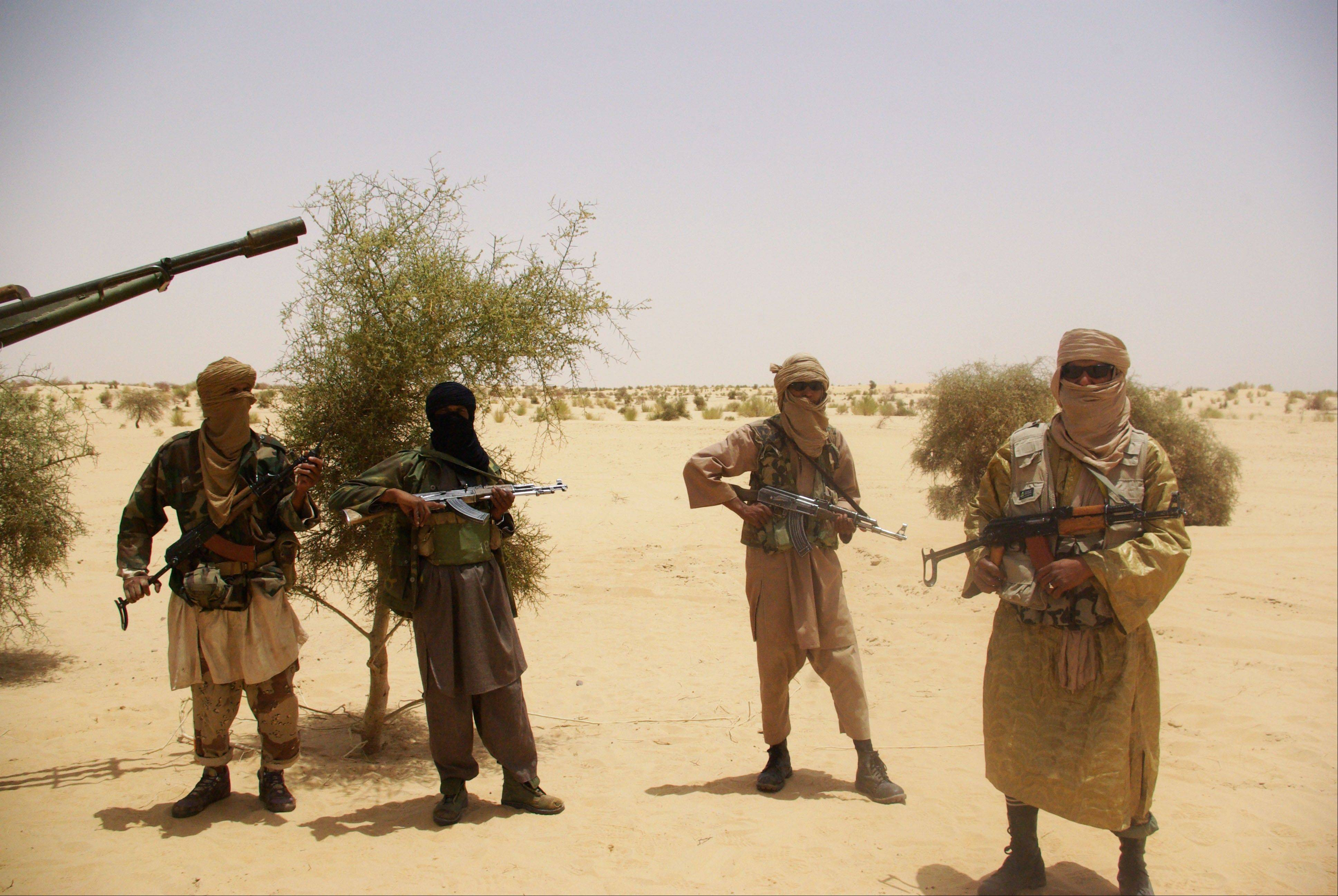 Associated Press/April 24, 2012Fighters from Islamist group Ansar Dine stand guard during a hostage handover in the desert outside Timbuktu, Mali.