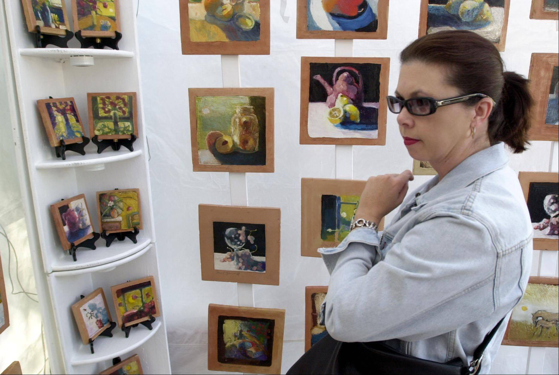Visitors to the Riverwalk Fine Art Fair are treated to seeing original works by artists from all over the country. The fair runs Saturday and Sunday in downtown Naperville.