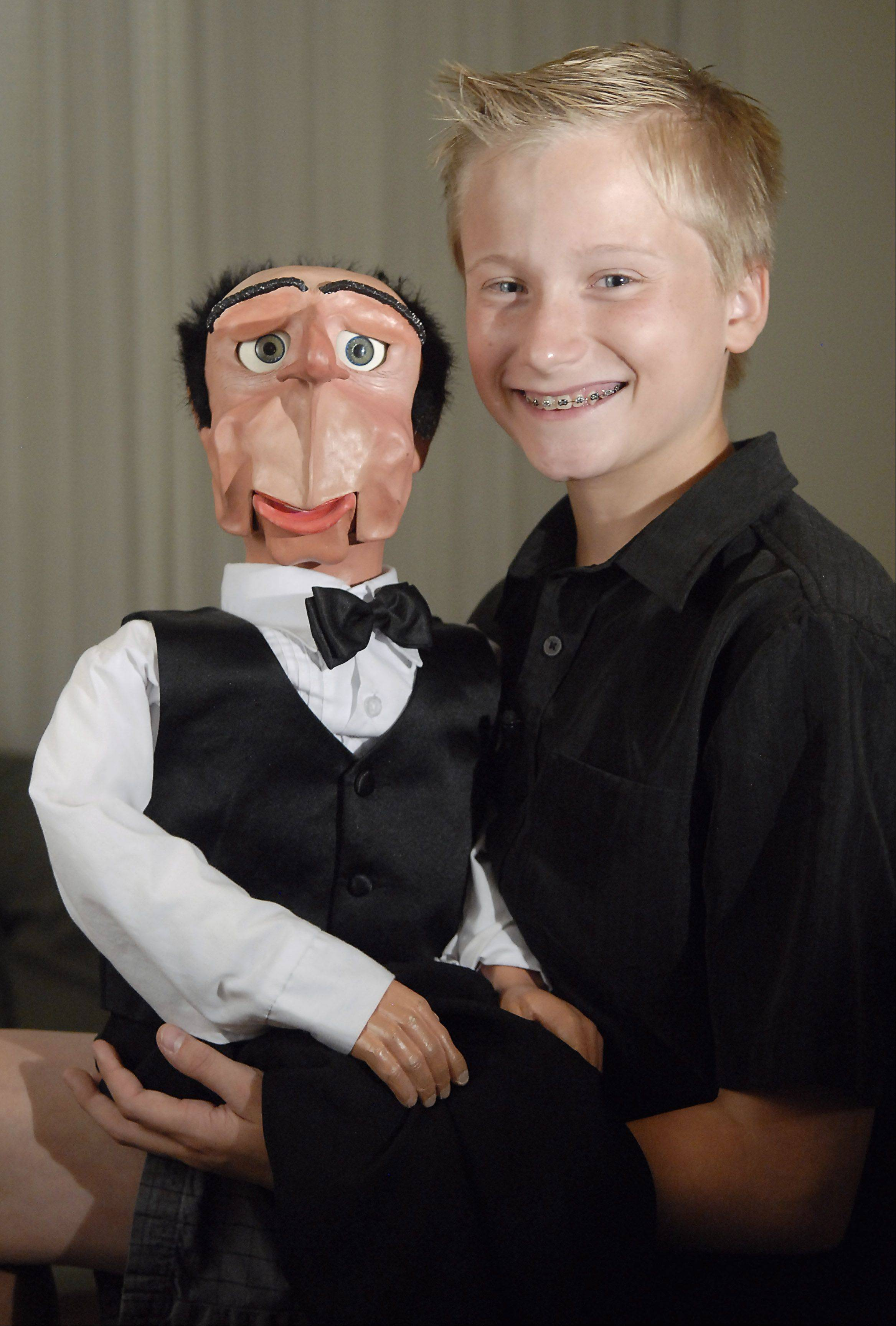 Twelve-year-old ventriloquist Noah Simmons of Huntley with one of his five characters, Sidney, who is British.