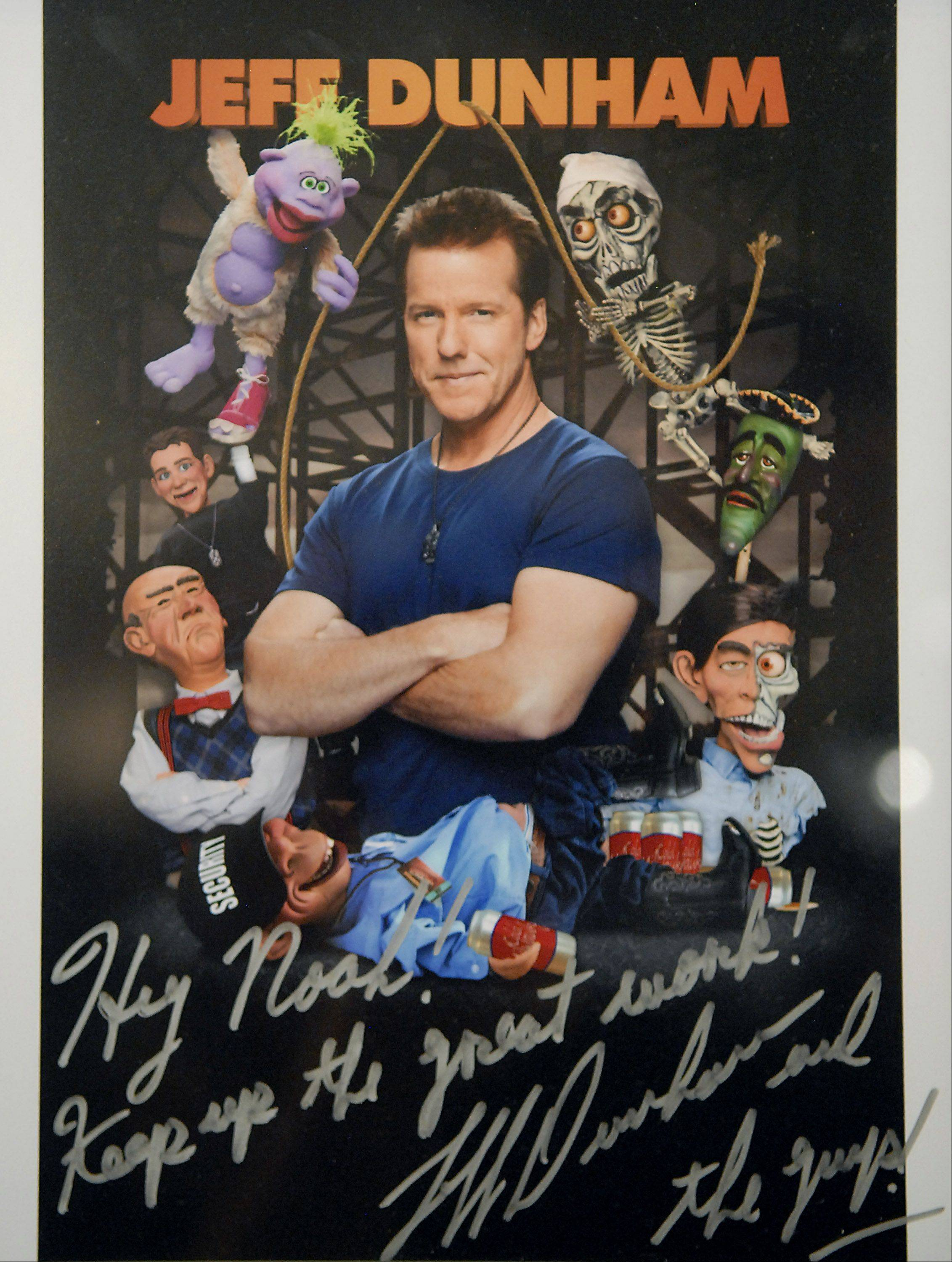 Twelve-year-old ventriloquist Noah Simmons of Huntley received this autographed photo from professional ventriloquist Jeff Dunham after getting a surprise visit from him July 18.