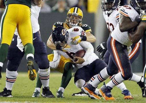 Green Bay Packers' Clay Matthews sacks Chicago Bears' Jay Cutler during the first half of an NFL football game Thursday, Sept. 13, 2012, in Green Bay, Wis.