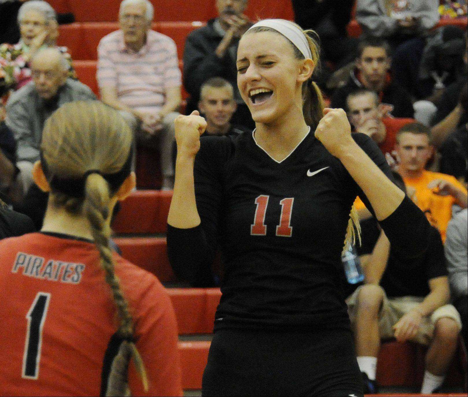 Palatine's Taylor Fricano and Casey Dolen celebrate a victory in set one over Fremd on Thursday at Palatine.