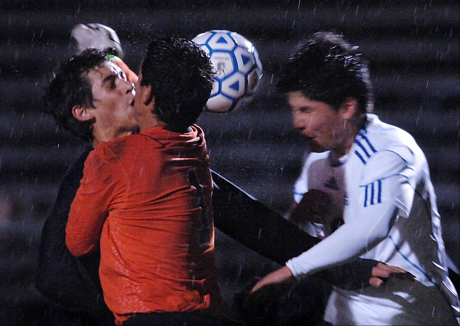 Metea Valley goalkeeper Gabe Gongora-Falla collides with teammate Jack Staton as Larkin's Erik Rodriguez tries to head the corner kick Thursday in Elgin. There was no goal on the play.