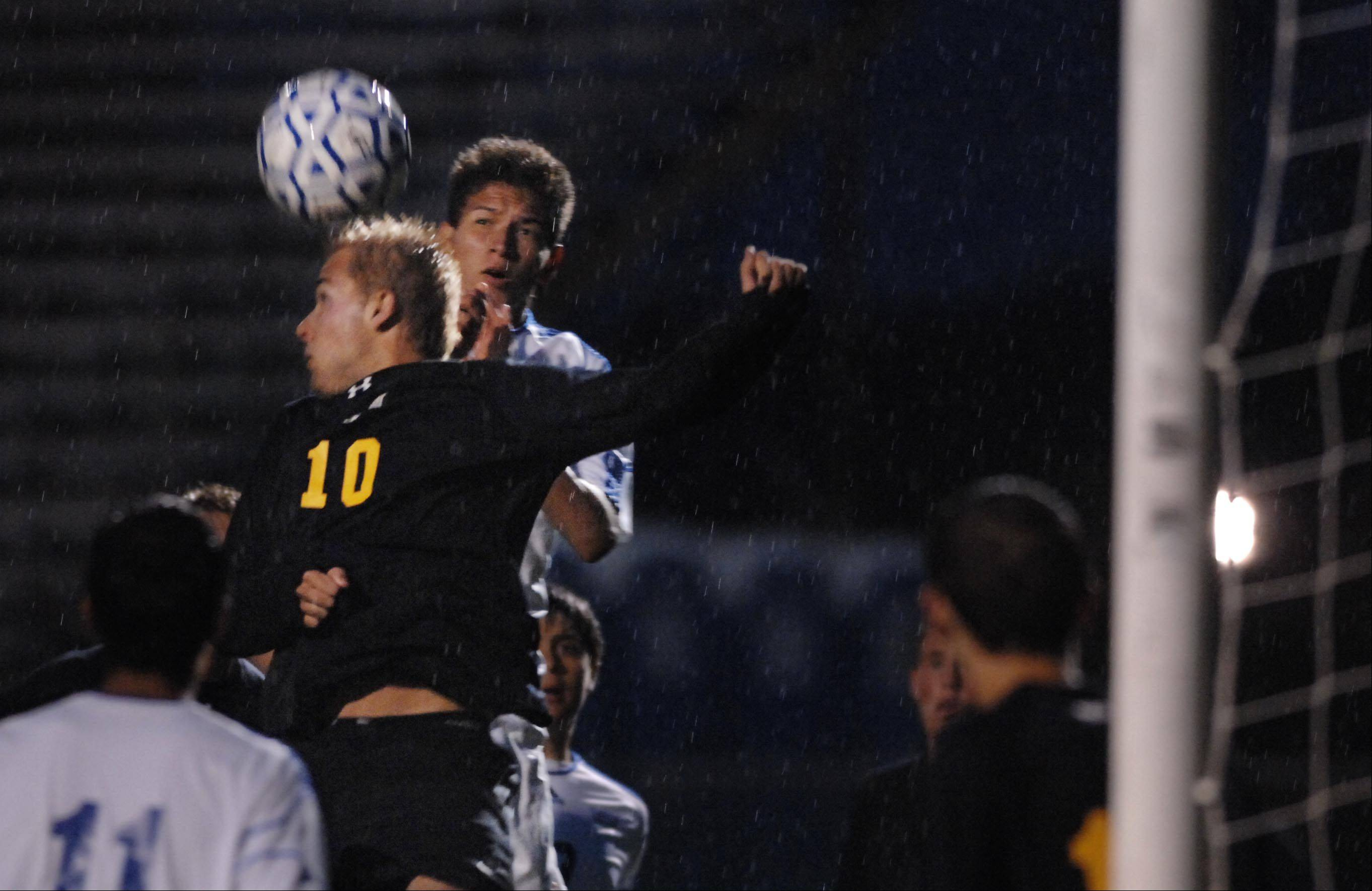 Larkin's Jorge Sibrian, right, and Metea Valley's Jake Goehring compete for a header in front of the Metea net Thursday in Elgin.