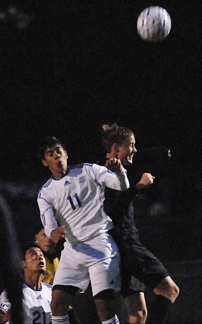 Larkin's Diego Ramirez and Metea Valley's Dakota Rowsey, right, compete for a header Thursday in Elgin.
