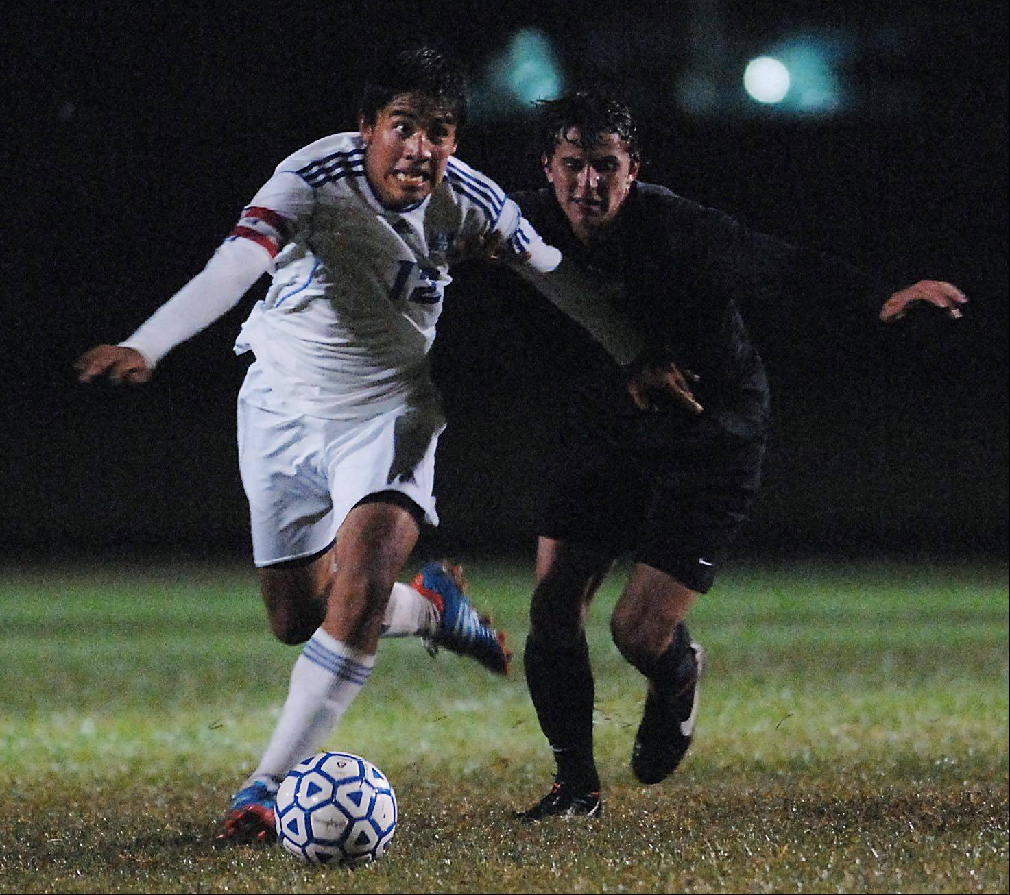 Larkin's Tony Hernandez takes control of the ball against Metea Valley's Franco Cattani Thursday in Elgin.