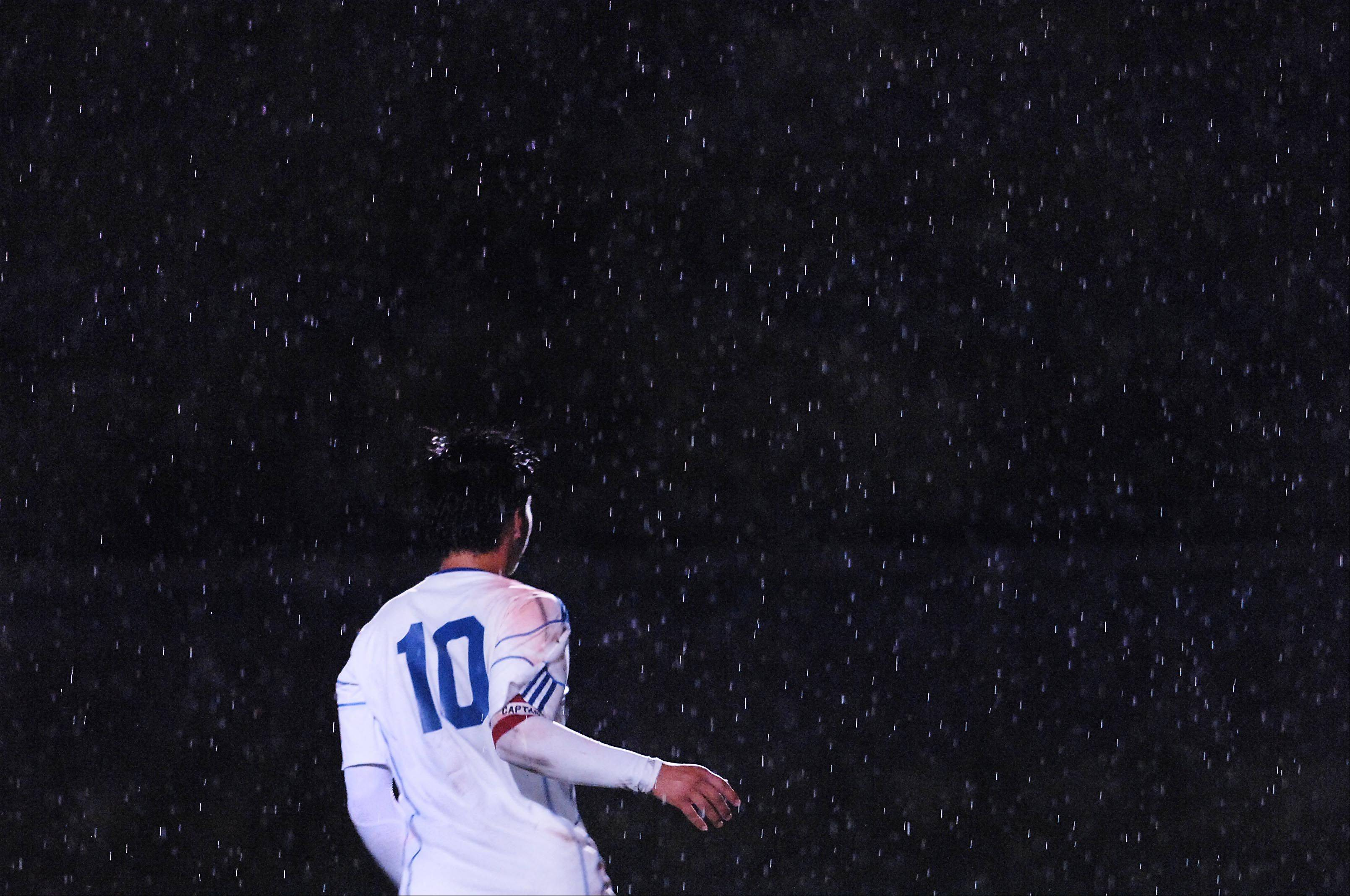 Larkin captain Erik Rodriguez plays in the rain against Metea Valley Thursday in Elgin.