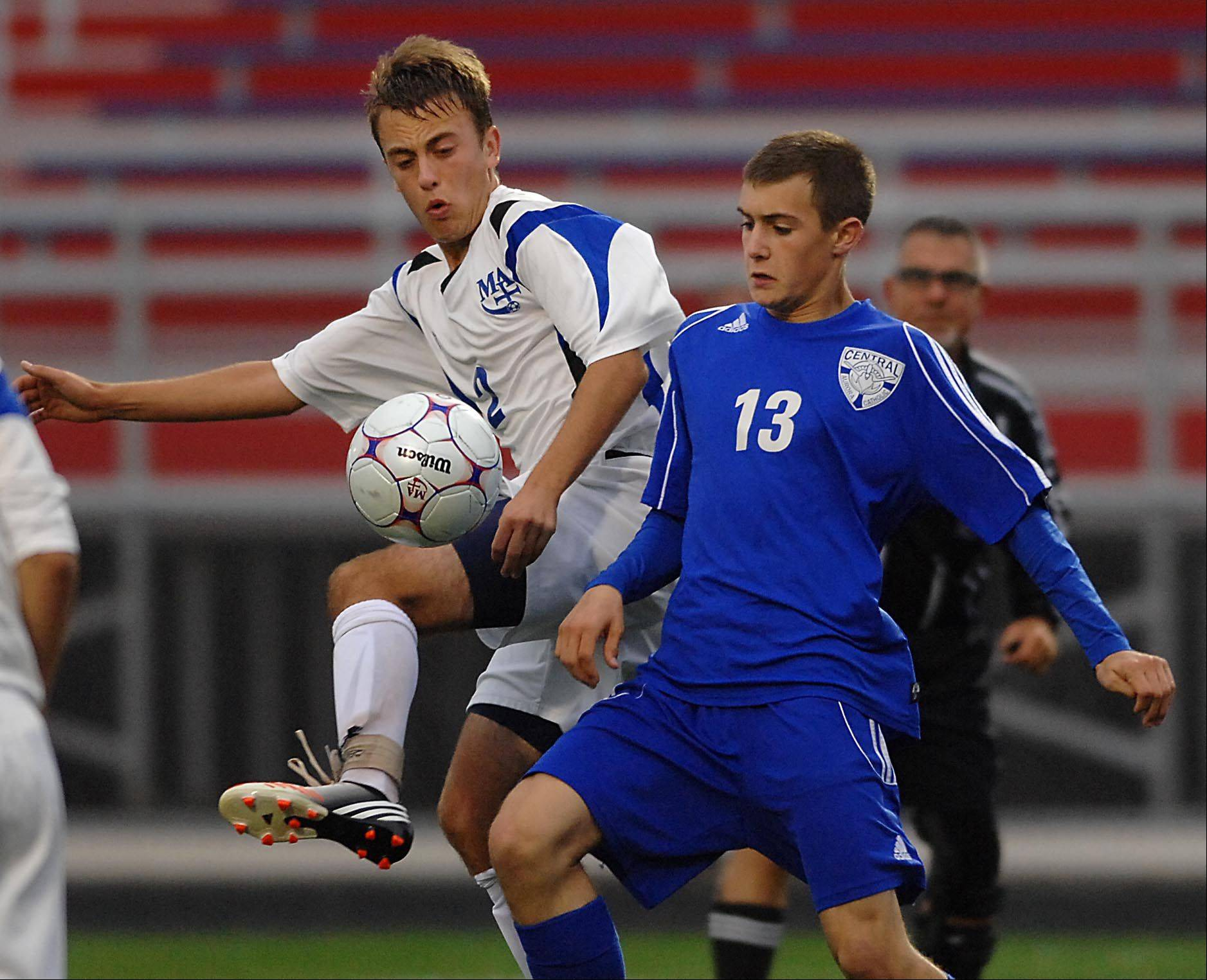 Marmion's Mick Wangler and Aurora Central Catholic's David Petesch, right, battle Thursday in Aurora.