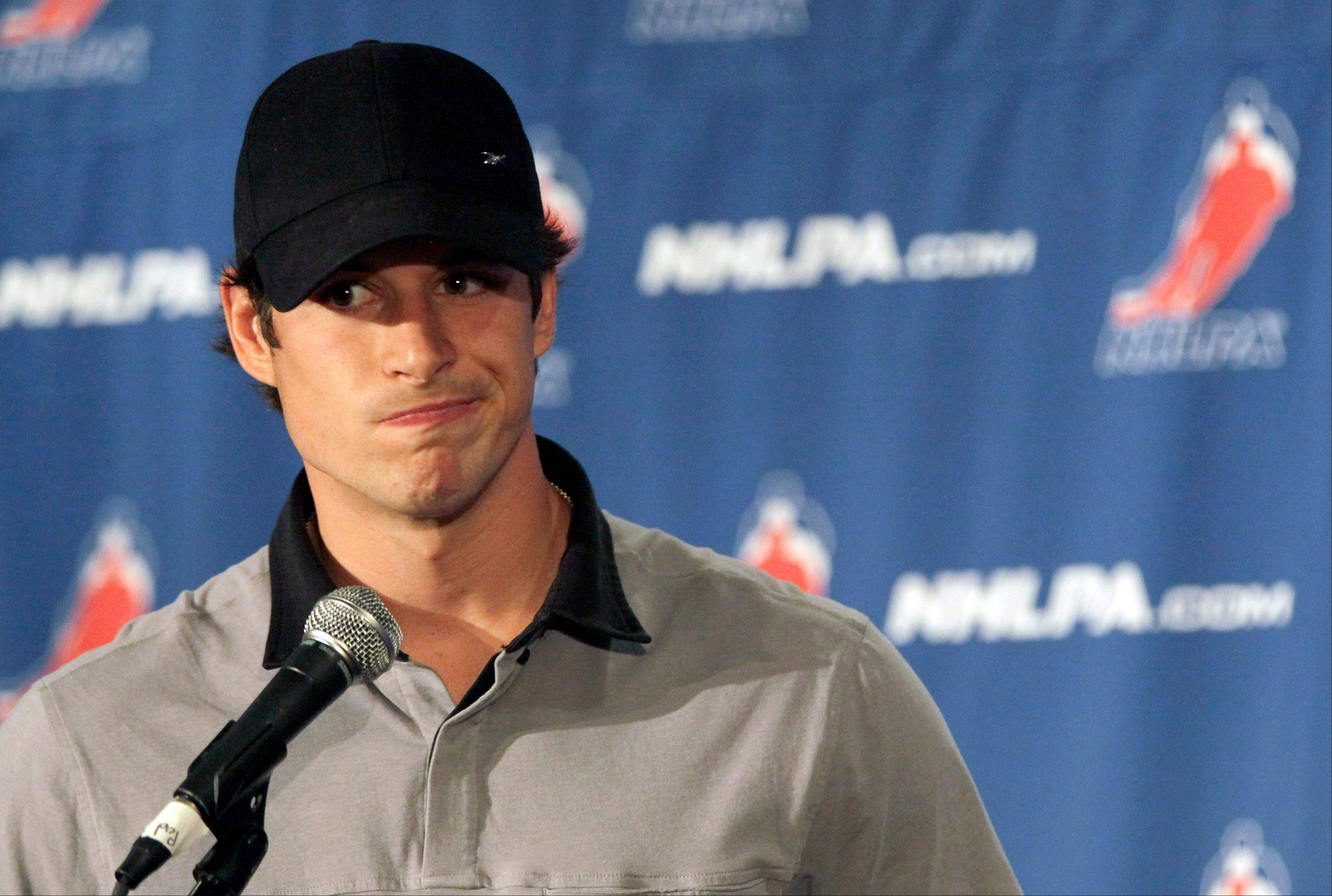 Sidney Crosby speaks to reporters Thursday during a news conference in New York. With a lockout looking increasingly certain, the NHL players union meets Thursday followed by an owners' meeting at league headquarters with Commissioner Gary Bettman.