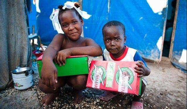 Two of the children who have received gift boxes through Operation Christmas Child.