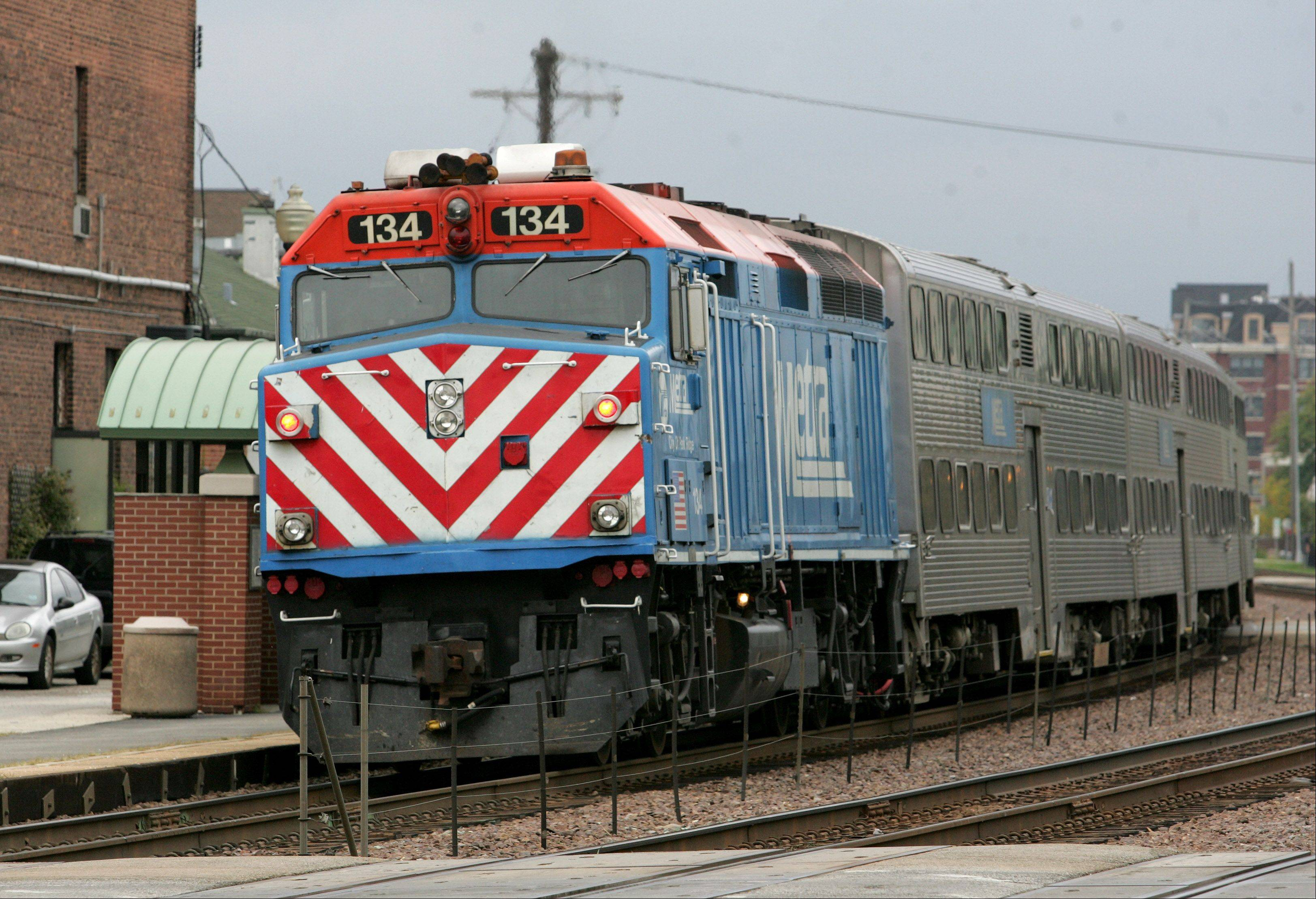 BEV HORNE/bhorne@dailyherald.com A Metra train leaves the Wheaton train station. Old rivalries between the suburbs and Chicago erupted Friday as Regional Transportation Authority leaders feuded over who should get $6 million � Pace, Metra or the CTA.